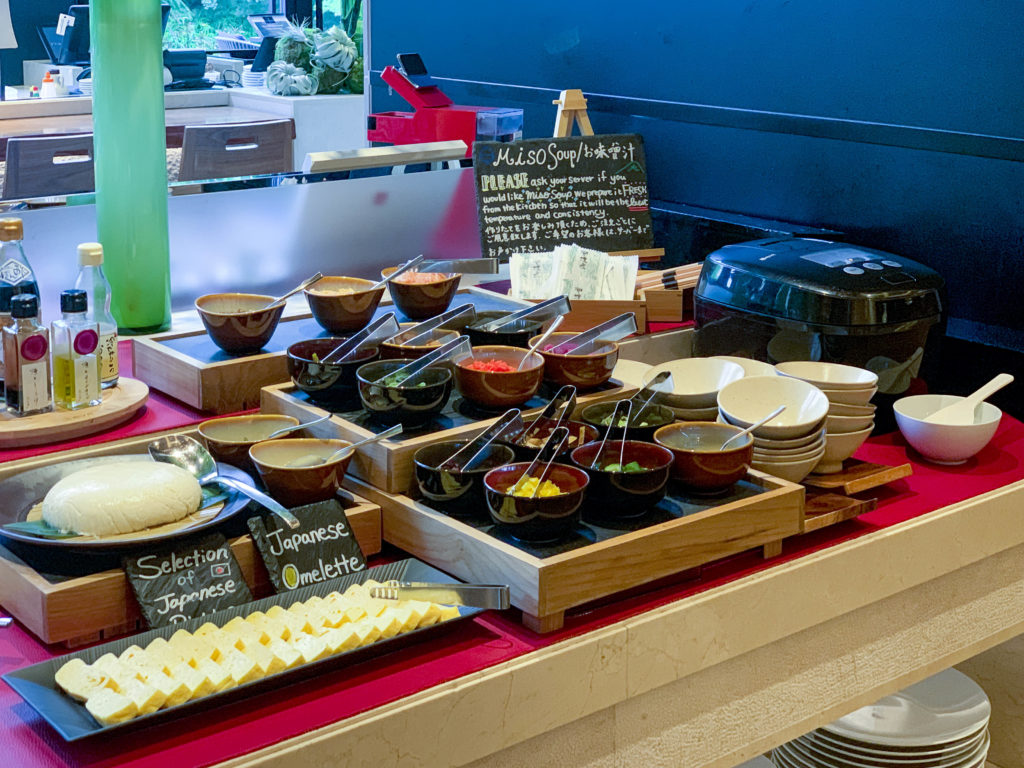 A miso soup station with small condiment dishes at the Brasserie breakfast buffet