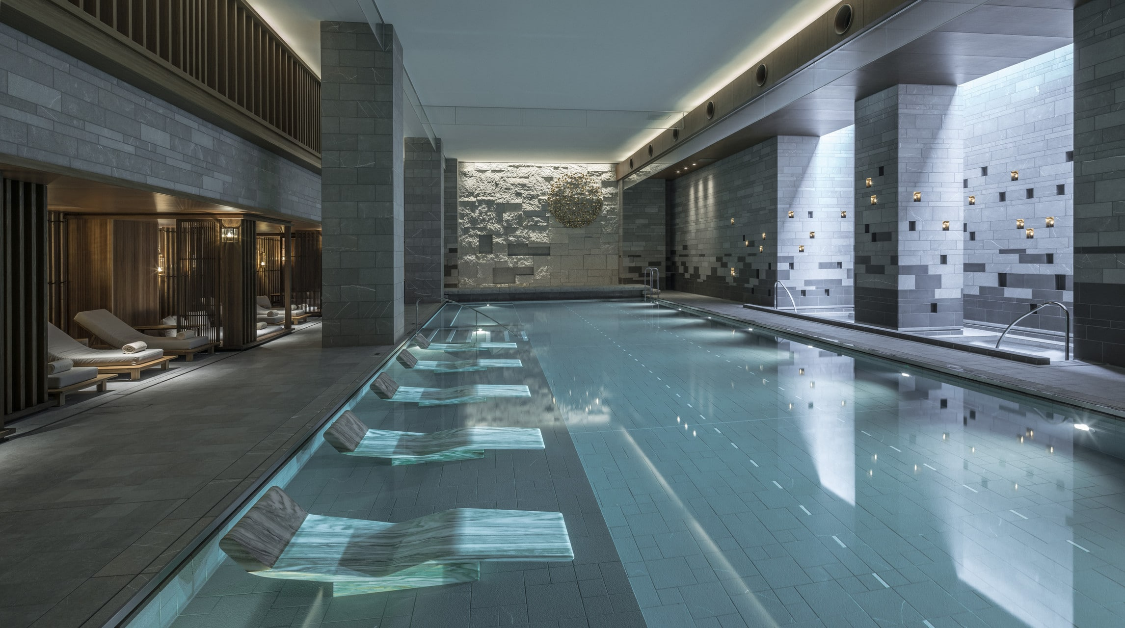 The sleek indoor pool with in-water lounge chairs and swimming lanes.