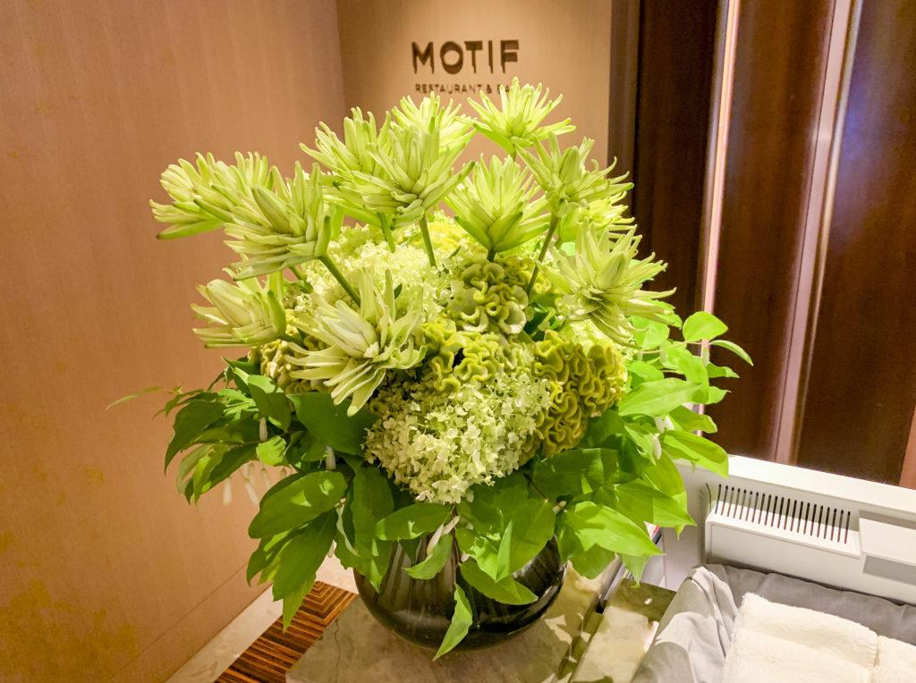 Green flower arrangement on the counter of Motif restaurant