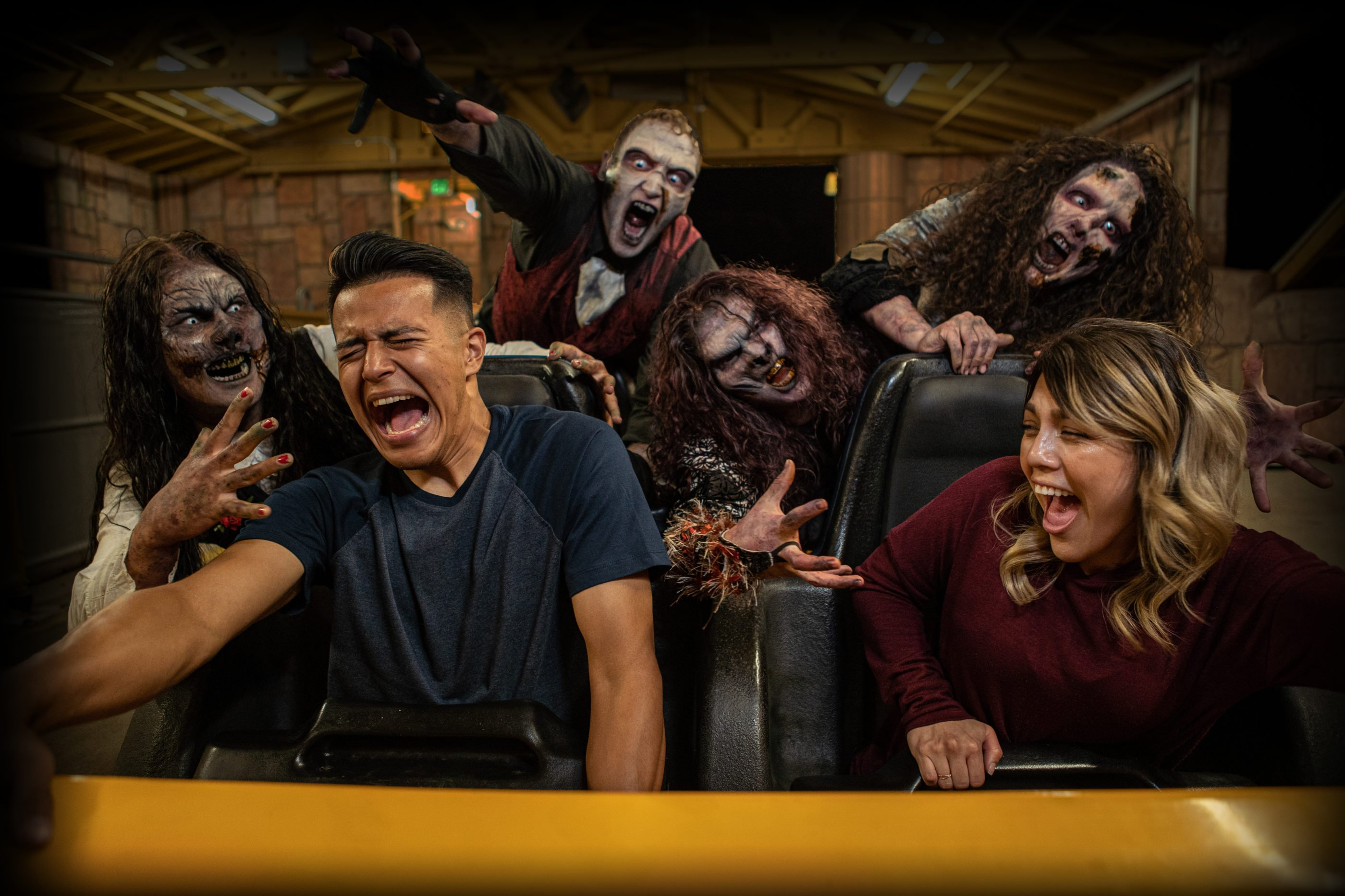 Ghouls scare riders as they board the Goliath roller coaster at Six Flags Magic Mountain.