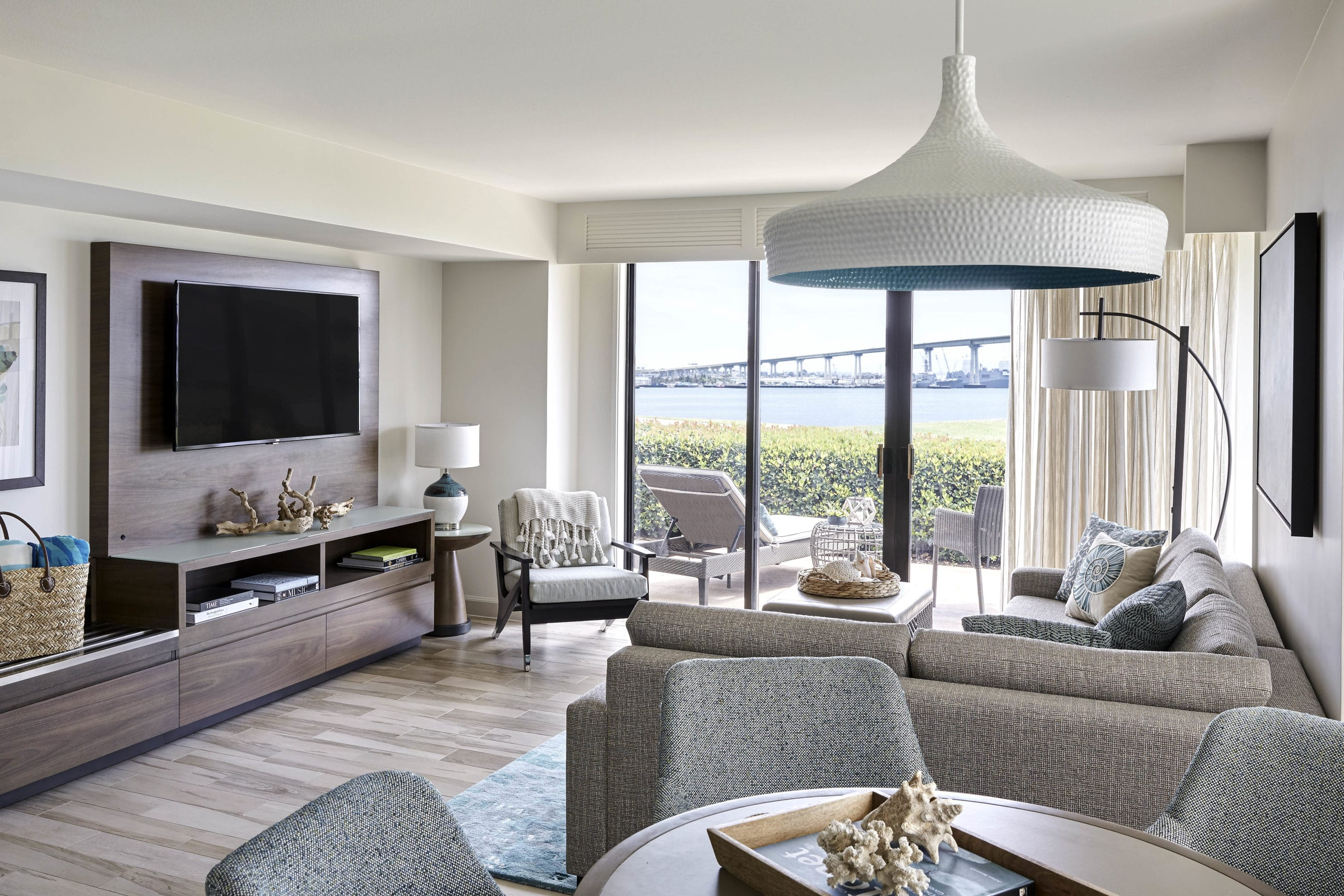 Living room of a Coronado Island Marriott one-bedroom cottage decorated in grey and neutral tones.