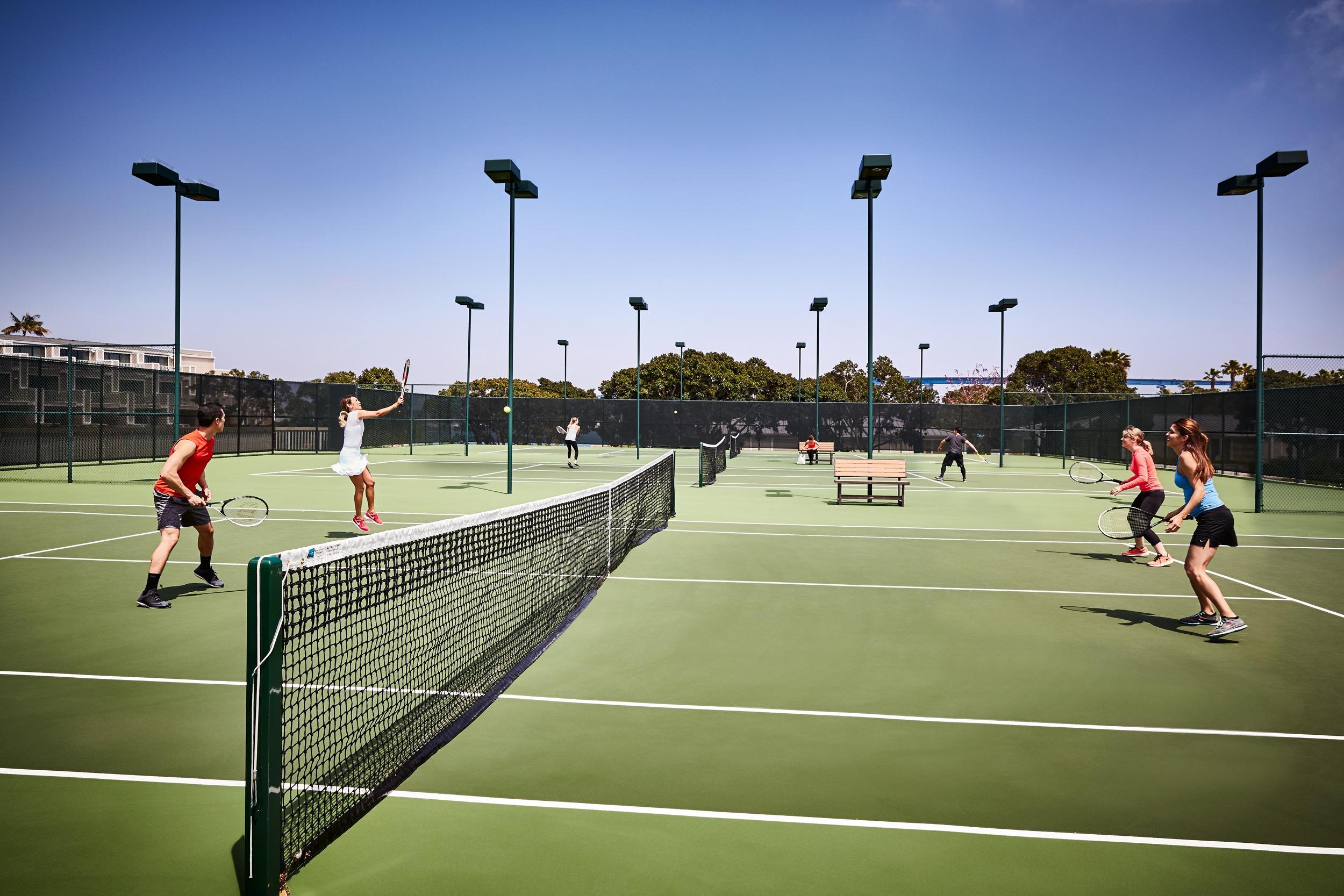 Guests play tennis at Coronado Island Marriott