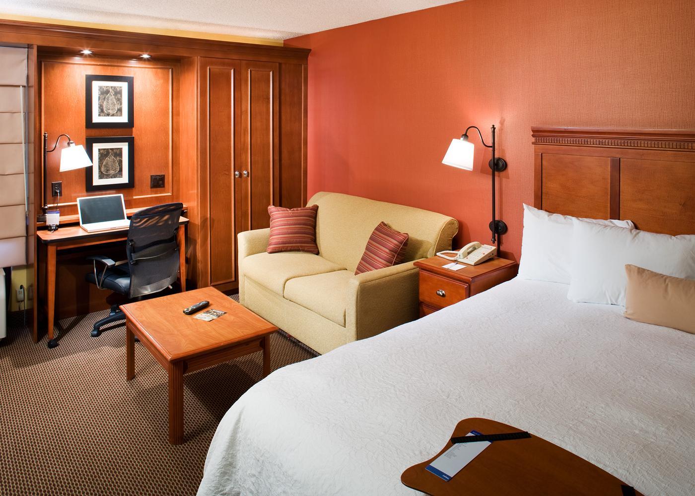 The interior of a room with orange and wood accents at Hampton Inn Santa Clarita.