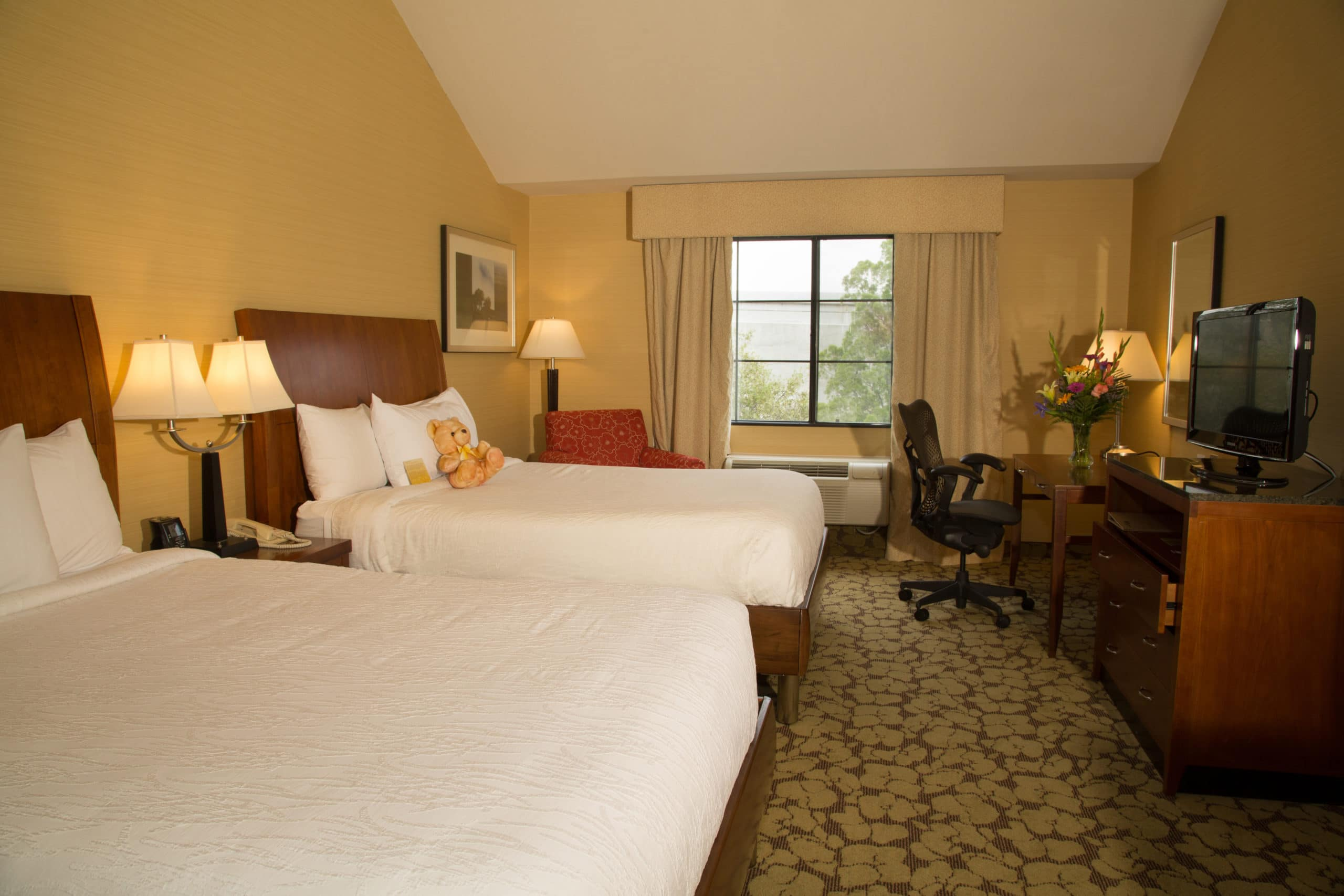A double room interior in neutral colors at Hilton Garden Inn Valencia, one of our top picks for Six Flags Magic Mountain hotels.