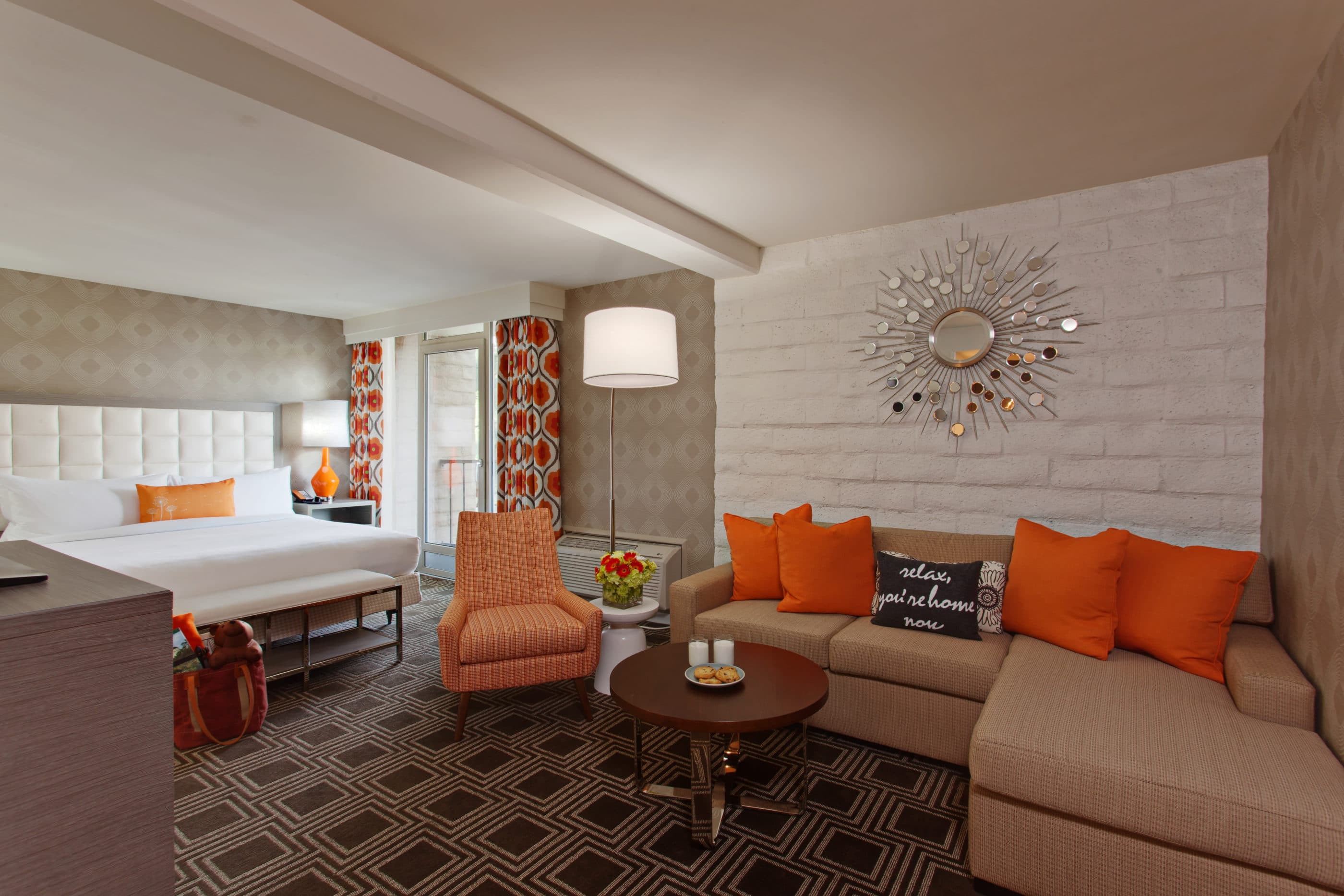 Family suite at The Garland with neutral tones and pops of orange in the typical Hollywood style.