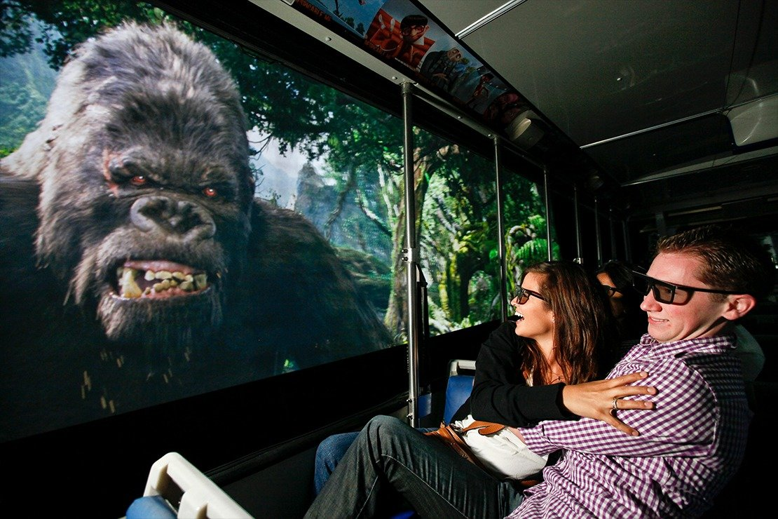 A couple wearing 3D glasses gets a close-up look at King King while sitting in the Studio Tour tram.