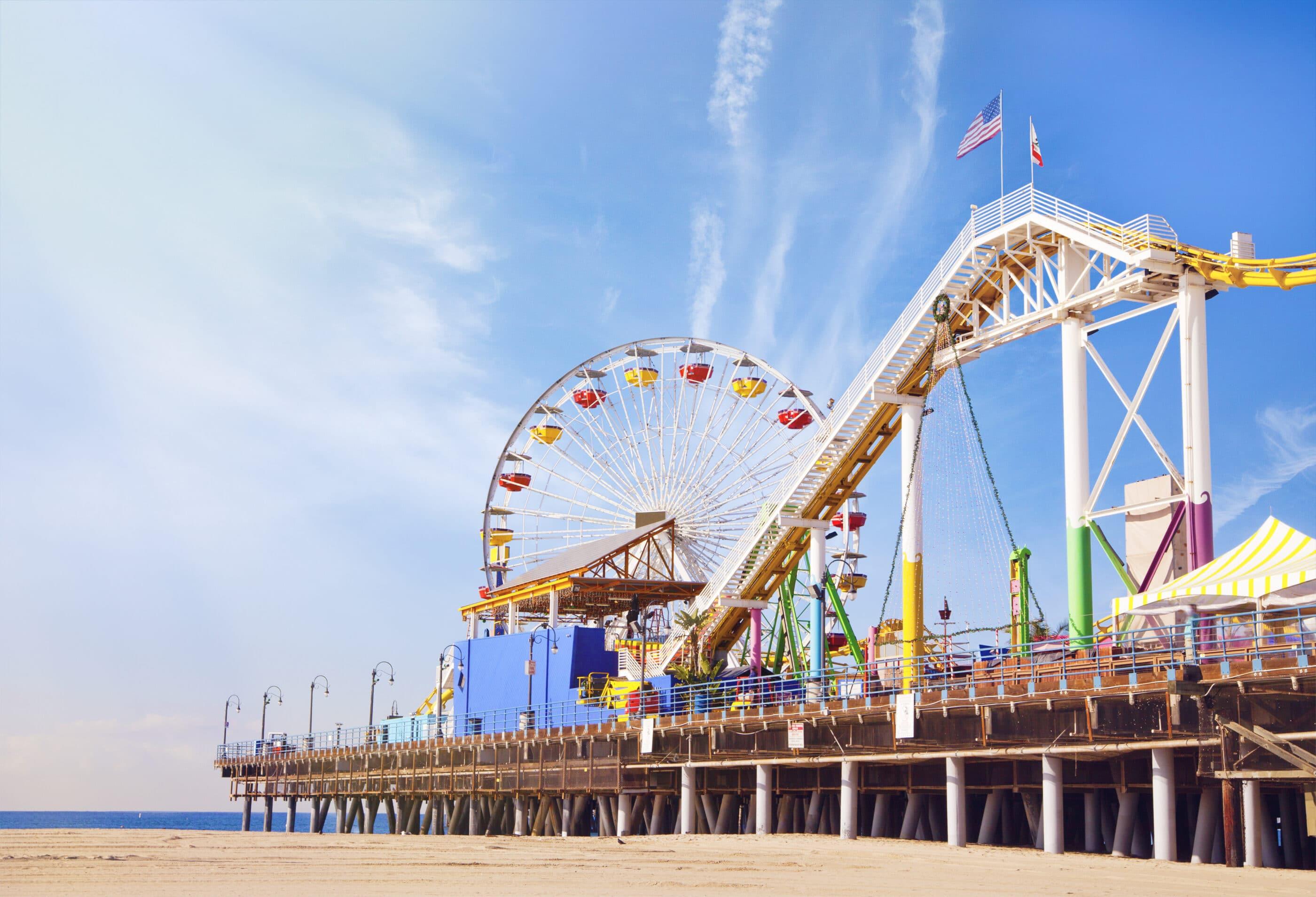 Ferris wheels and coaster on Santa Monica pier.