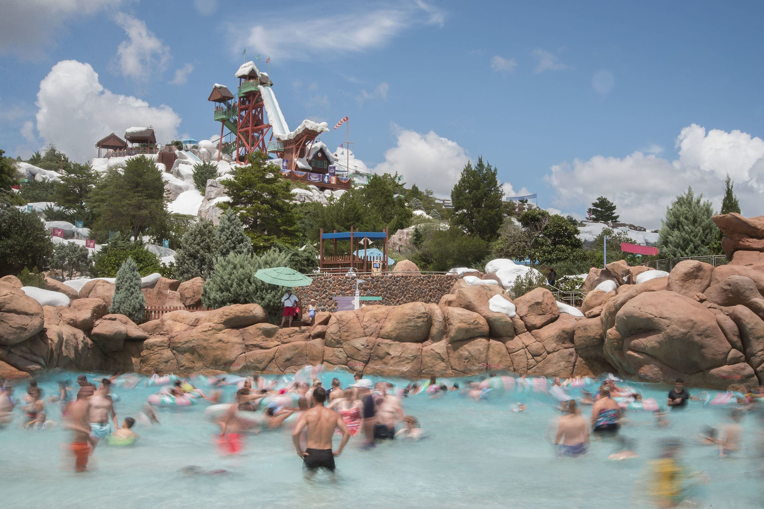 Guests splash around in the one-acre wave pool, Melt-Away Bay, at Disney's Blizzard Beach Water Park in Orlando, Florida.