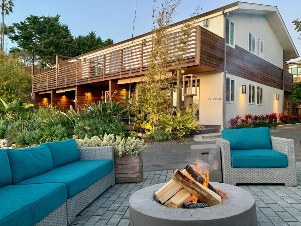 Outdoor fire pit surrounded by lounge chairs at Inn at Moonlight Beach