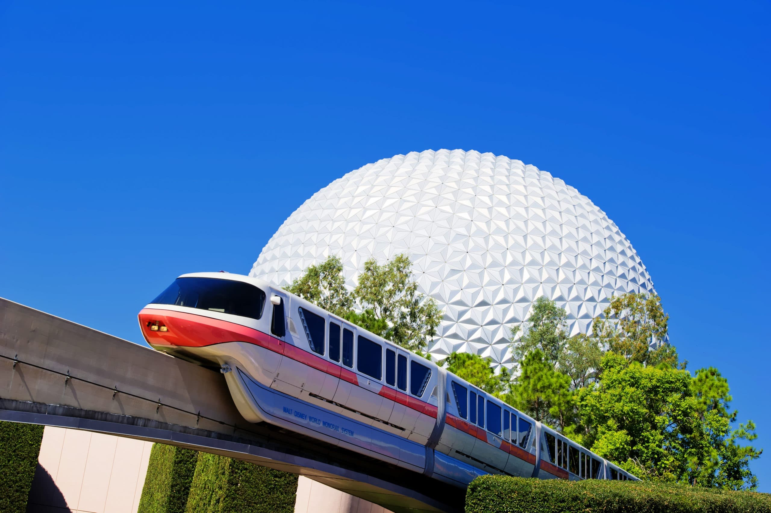 A monorail train passes by Spaceship Earth, the visual and thematic centerpiece of Epcot at Walt Disney World Resort