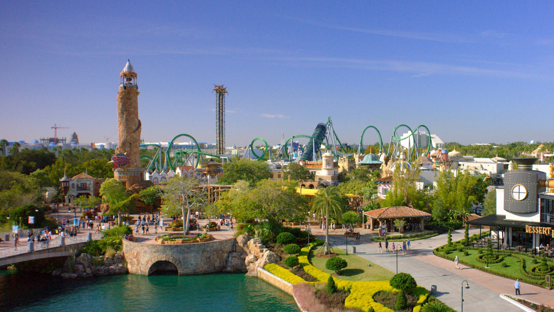 An overview of Universal's Islands of Adventure with the Hulk rollercoaster and more in the background.
