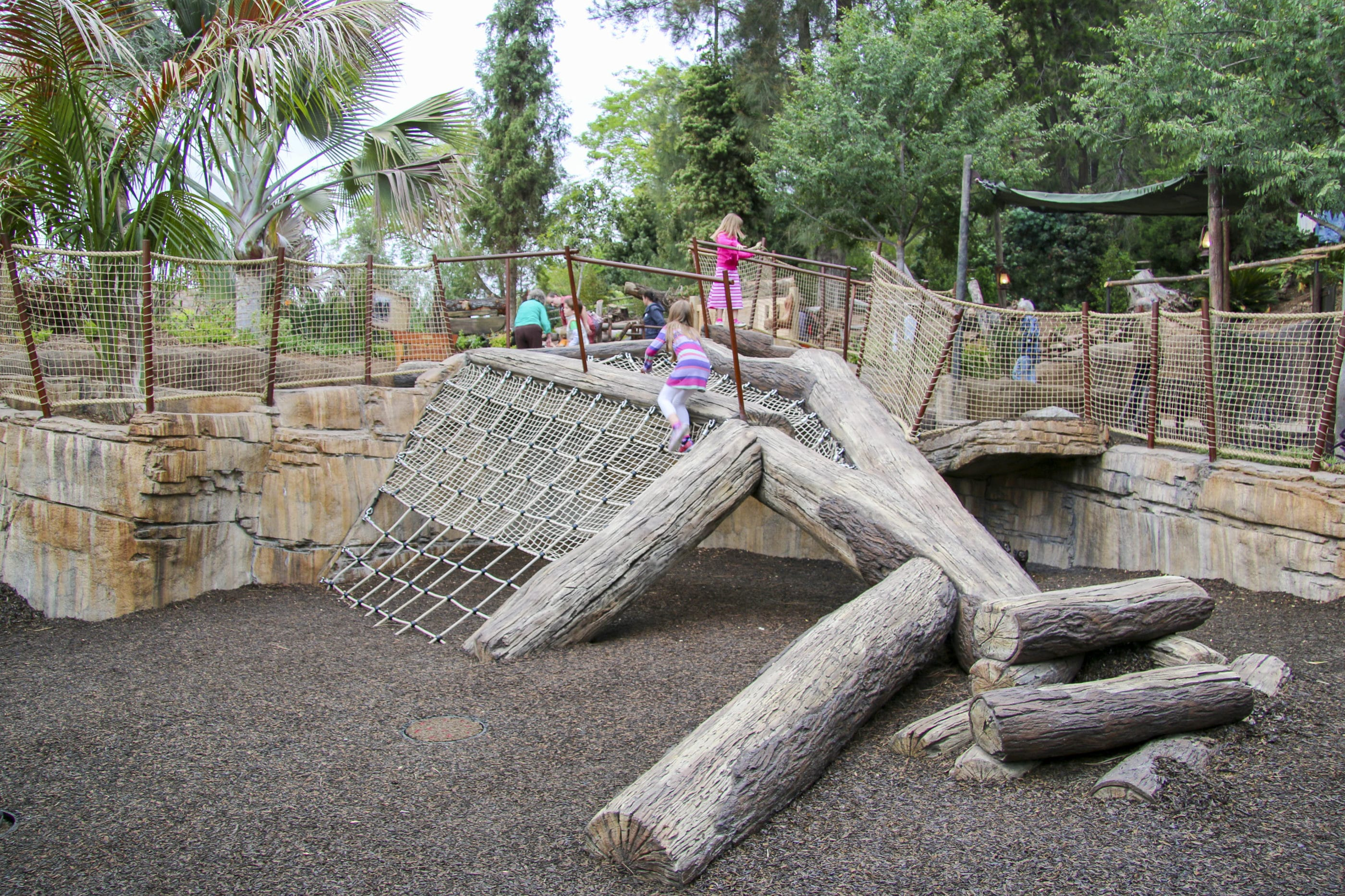 Kids play on the play structure in Tiger Trail at San Diego Zoo Safari Park.