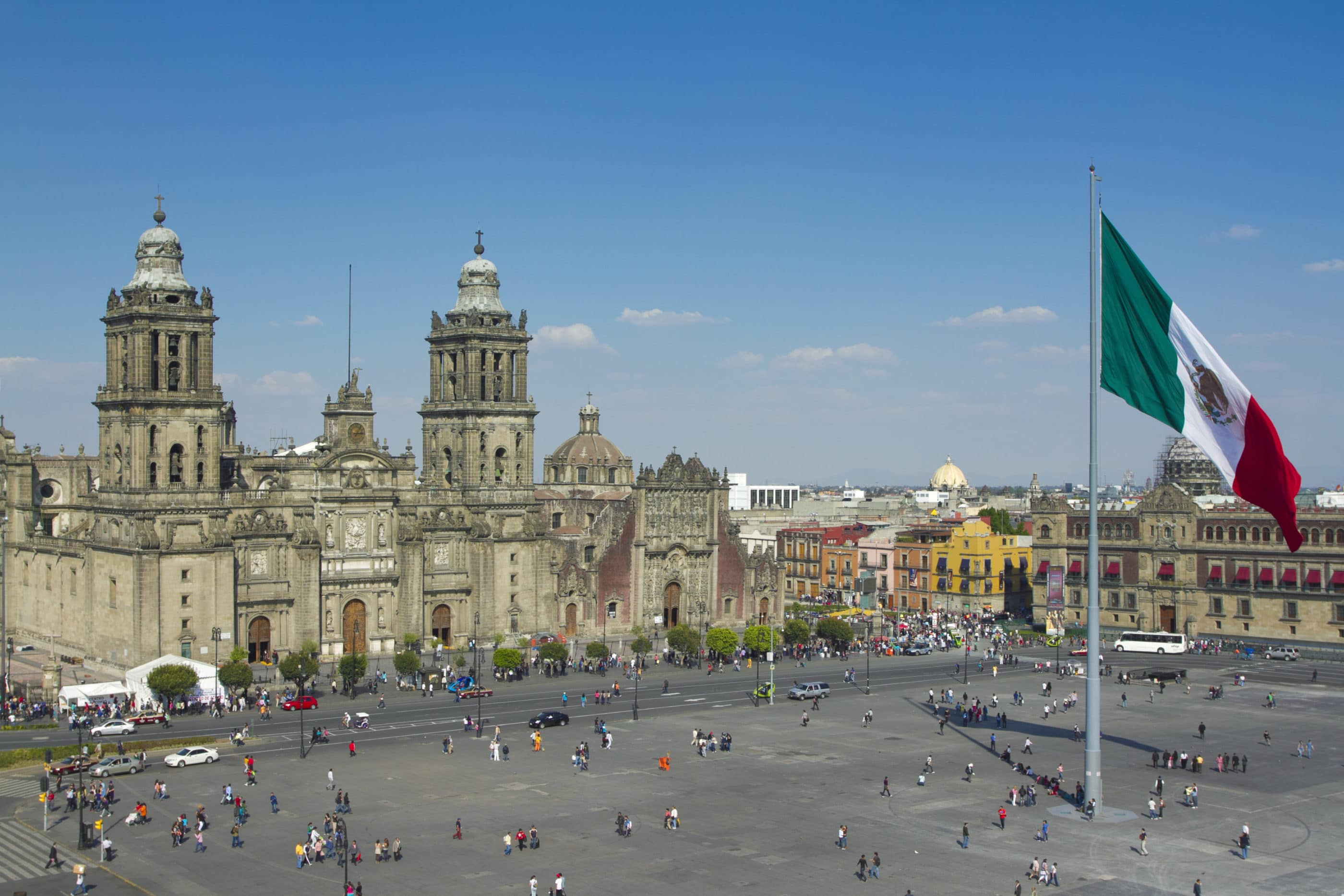 The Zocalo in Mexico City, with the cathedral and giant flag in the center.