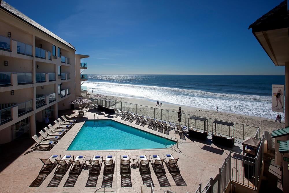 The pool at Beach Terrace Inn overlooks a tranquil beach.