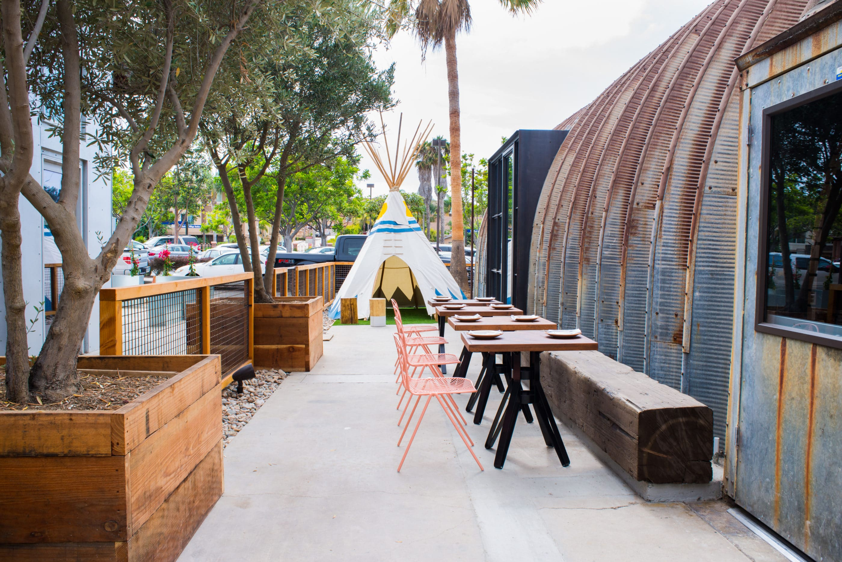 The outdoor seating area at Campfire including the tipi kids' play area.