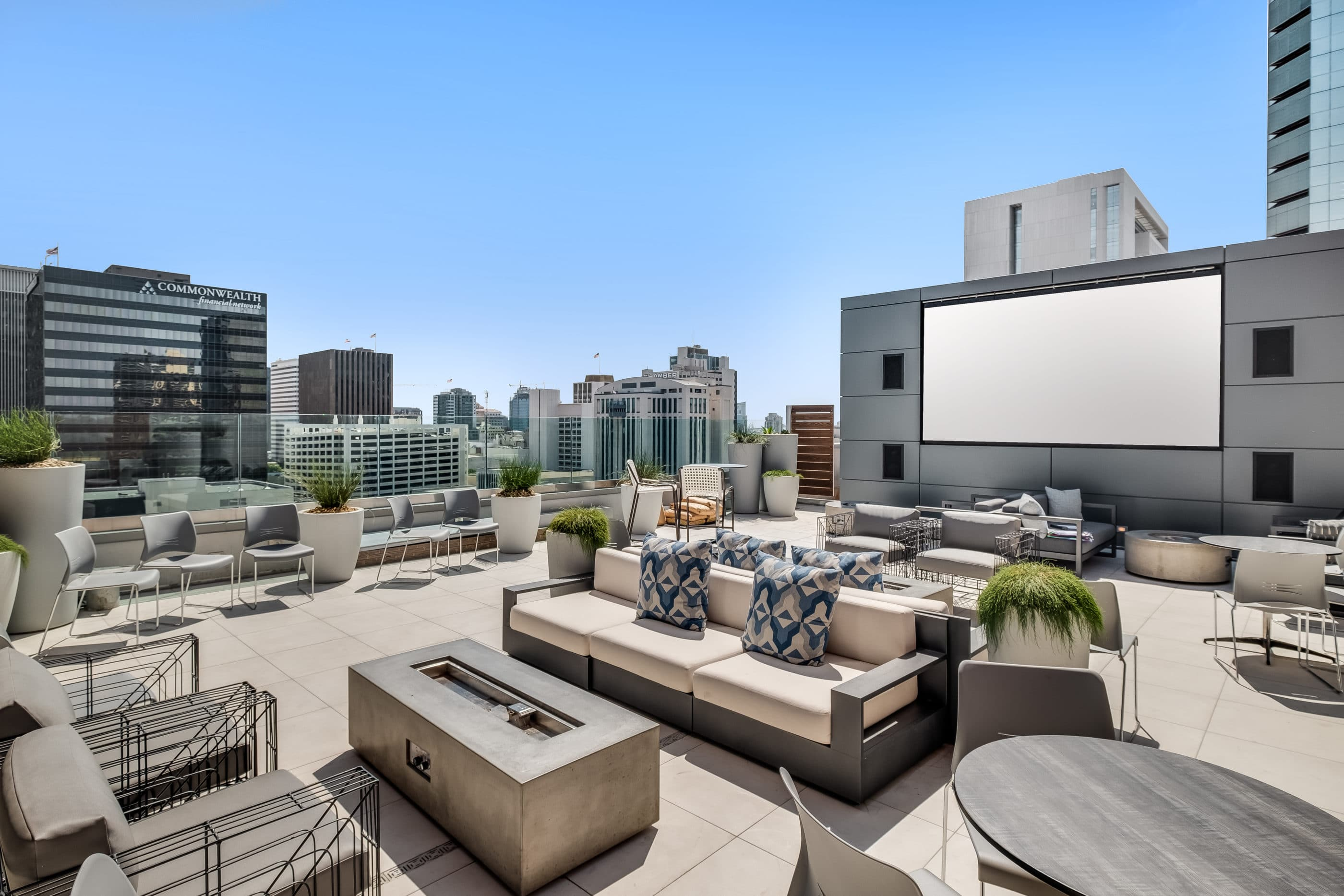 Rooftop lounge with large TV screen and outdoor seating areas at Carte Hotel San Diego.