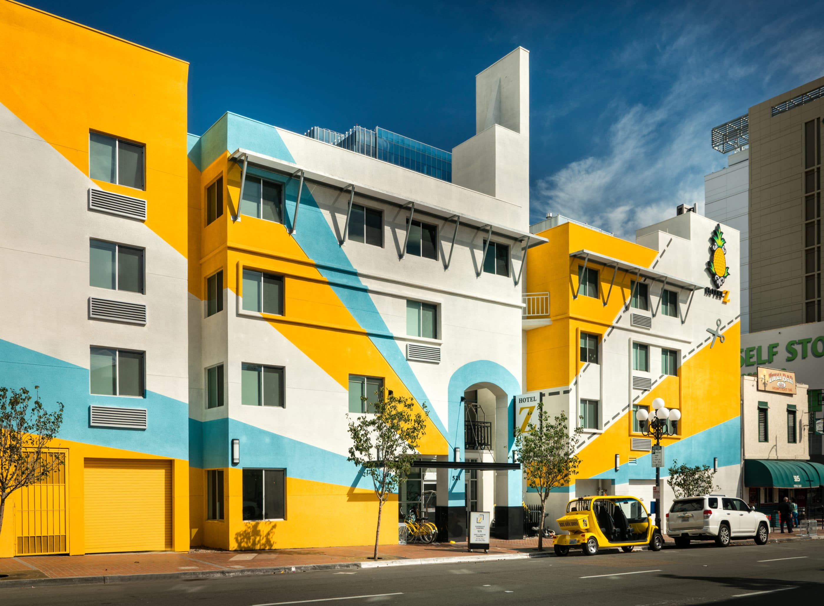 The bright blue and yellow exterior of Hotel Z – San Diego, one of the most eclectic boutique hotels in San Diego.