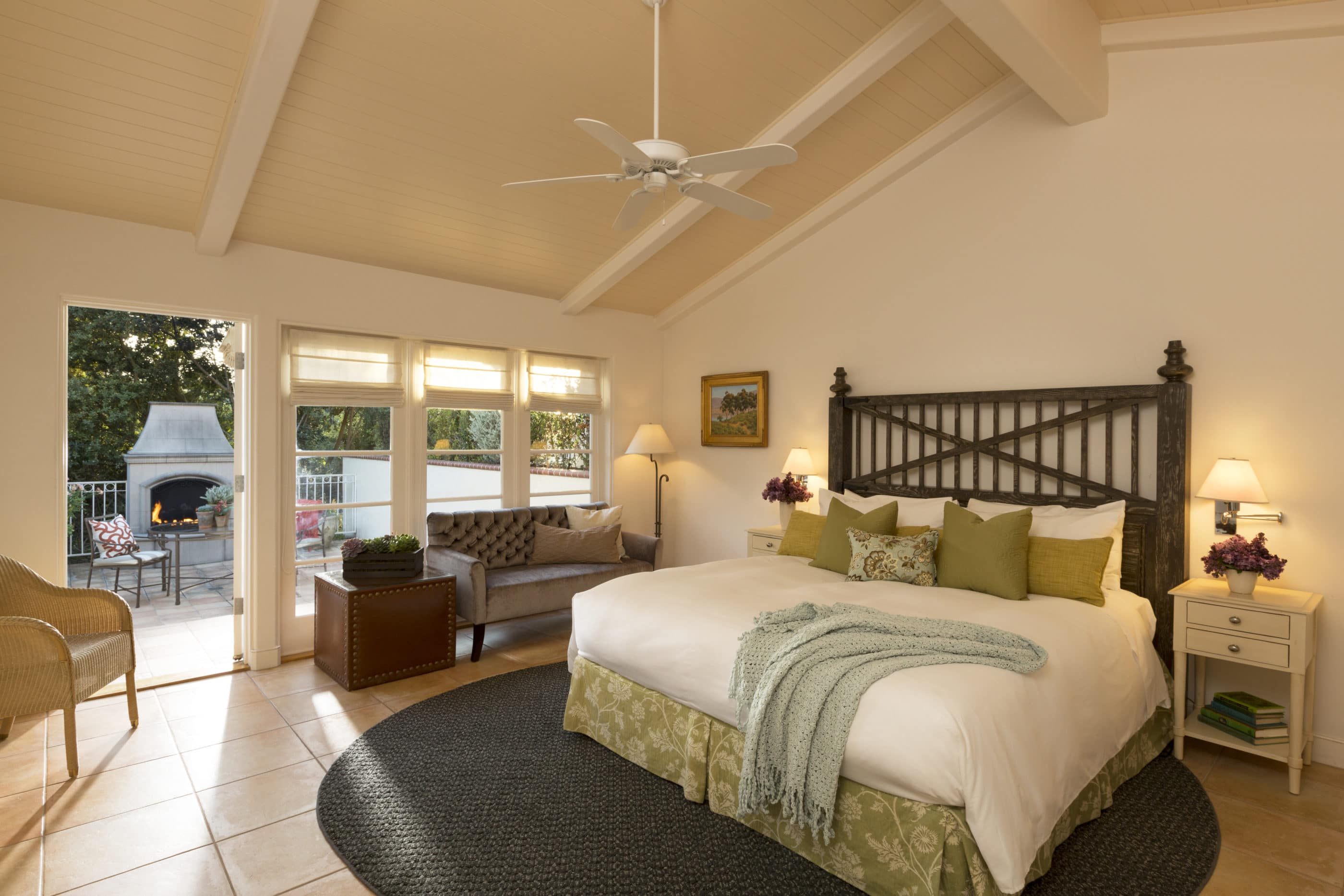 A gorgeous king room with an outdoor patio fireplace at The Inn at Rancho Santa Fe