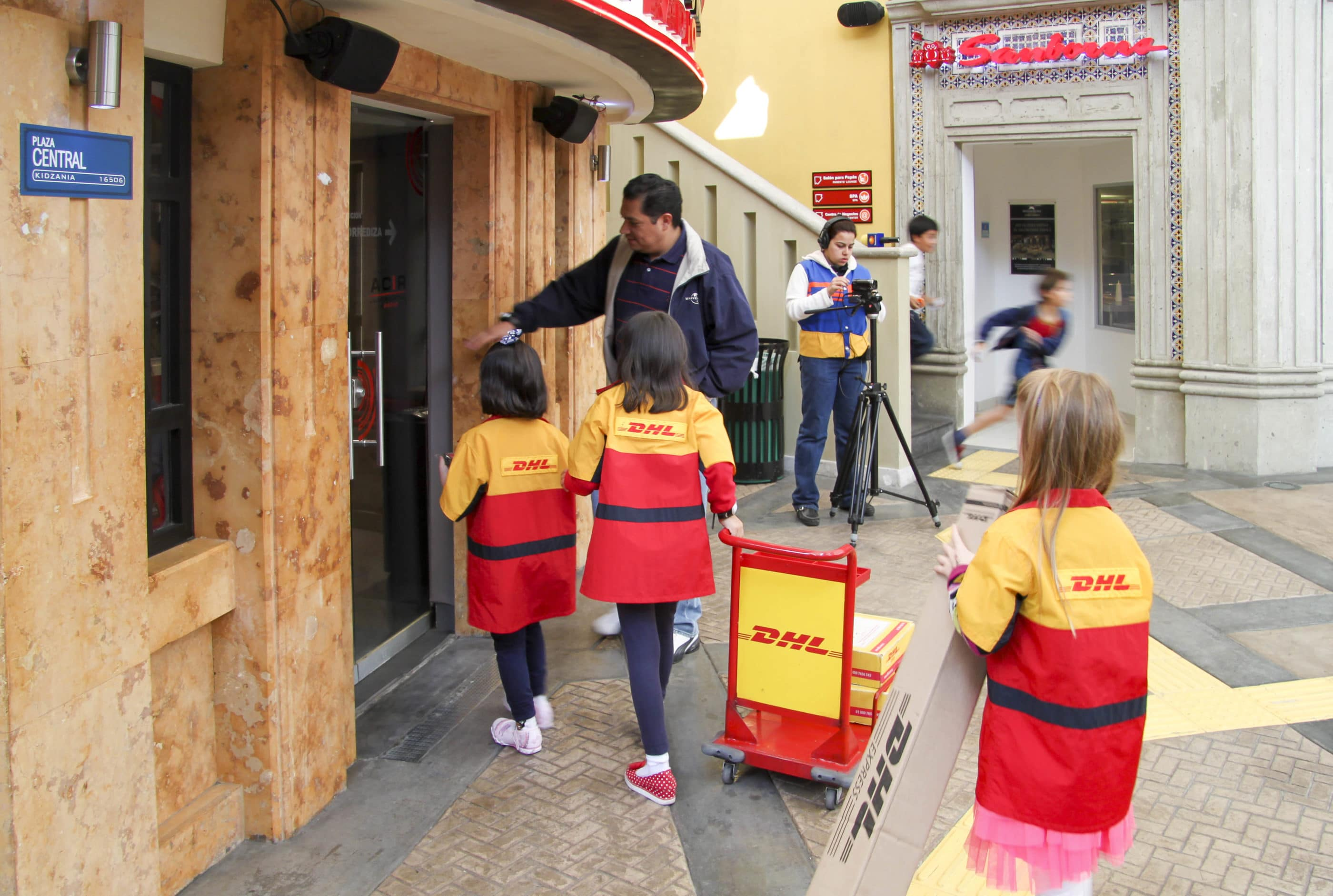 Kids delivering packages as DHL workers at Kid City, a theme park where they can role play adult careers.