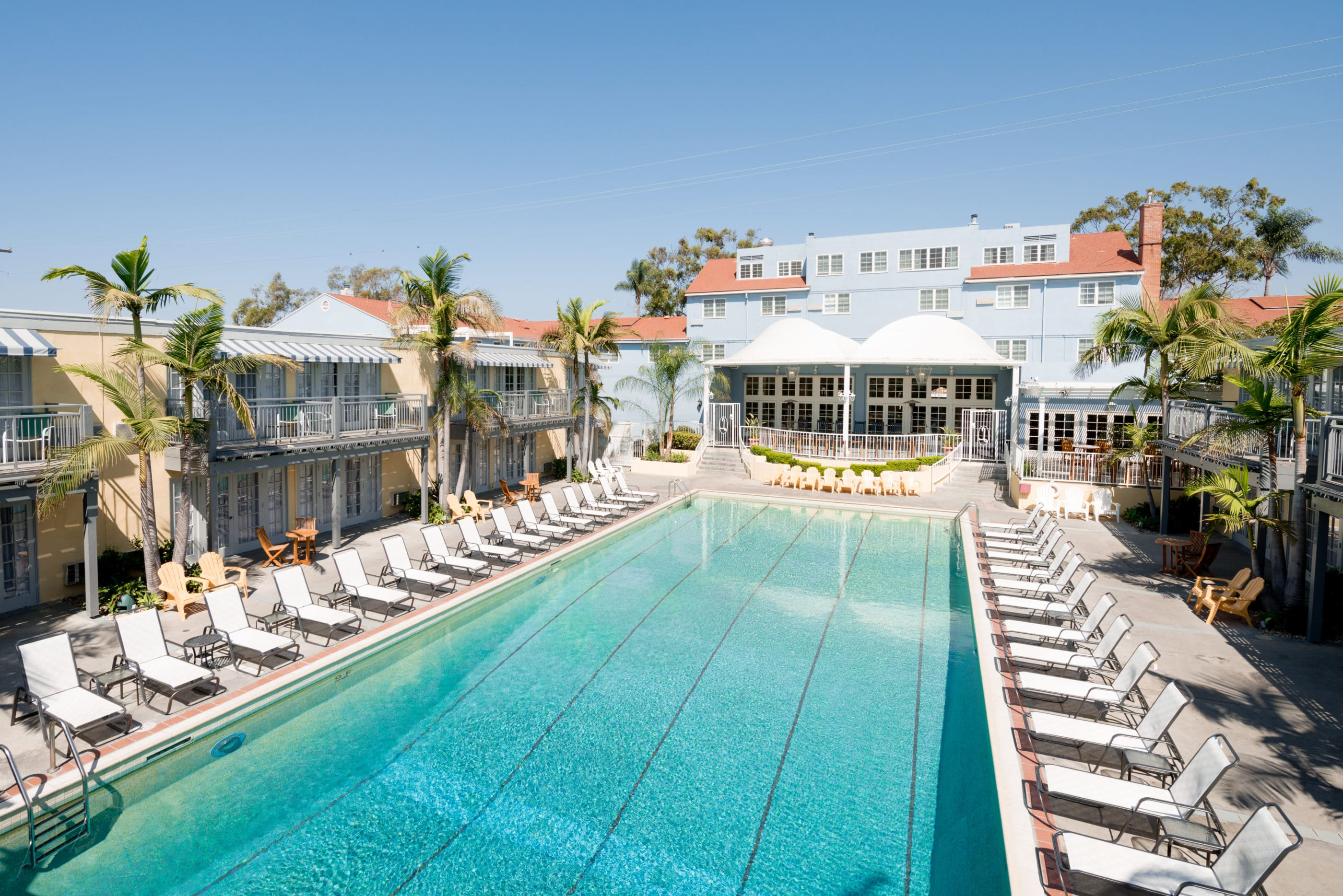 The famous pool surrounded by lounge chairs at The Lafayette Hotel, Swim Club and Bungalows in San Diego.