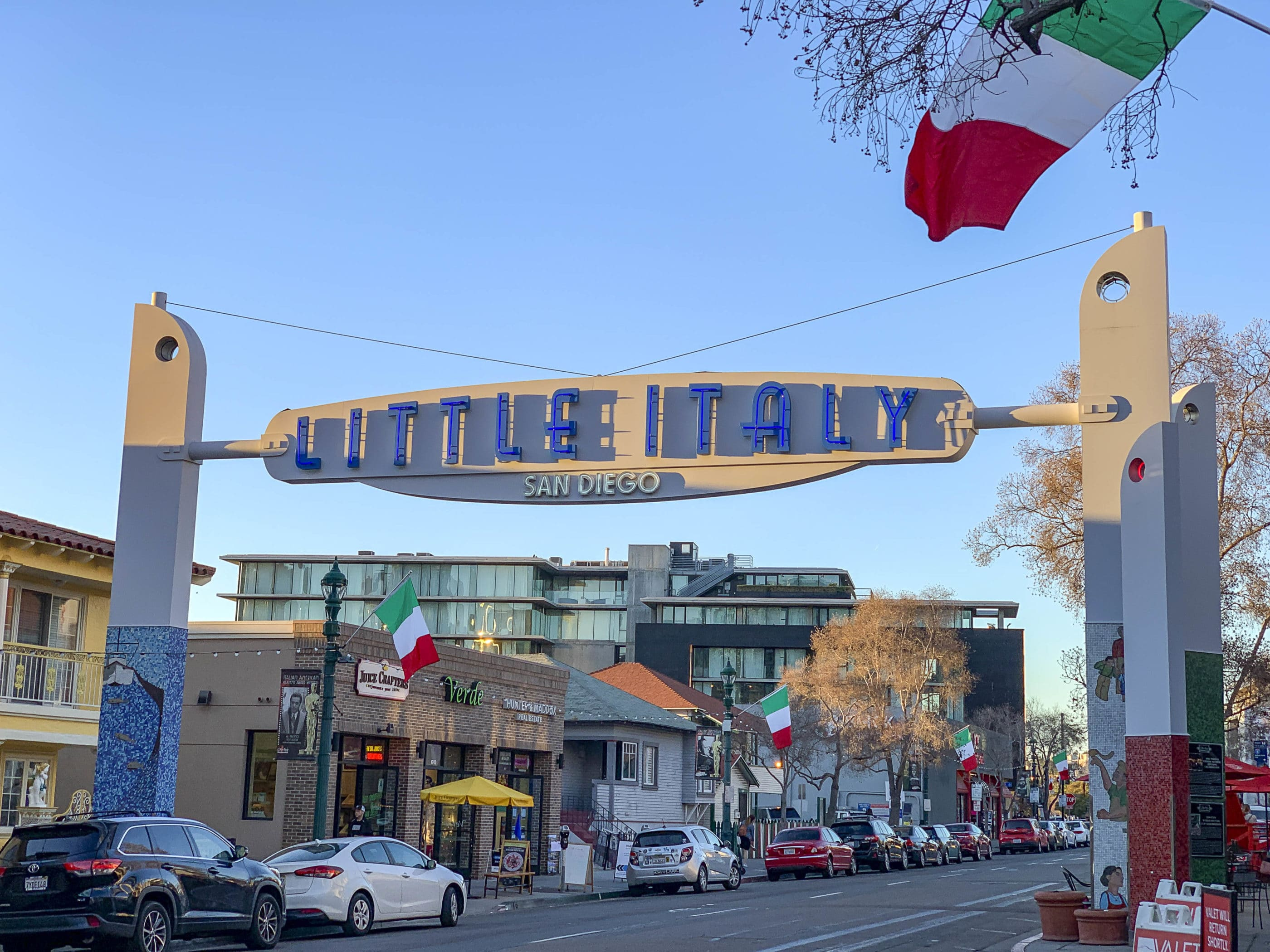 The sign for Little Italy San Diego in February with blue skies