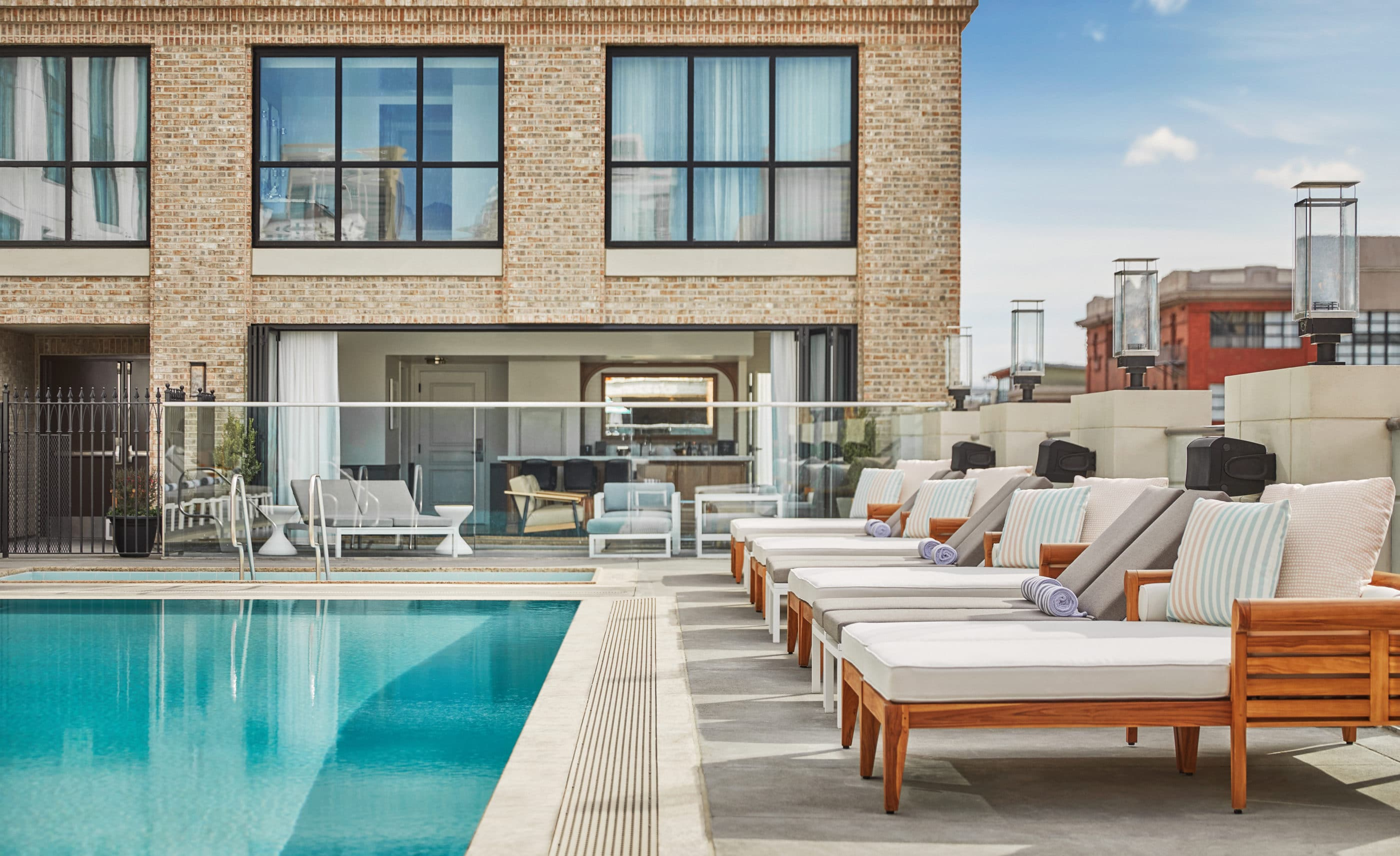 Plush lounge chairs by the pool at Pendry San Diego, one of our favorite boutique hotels.
