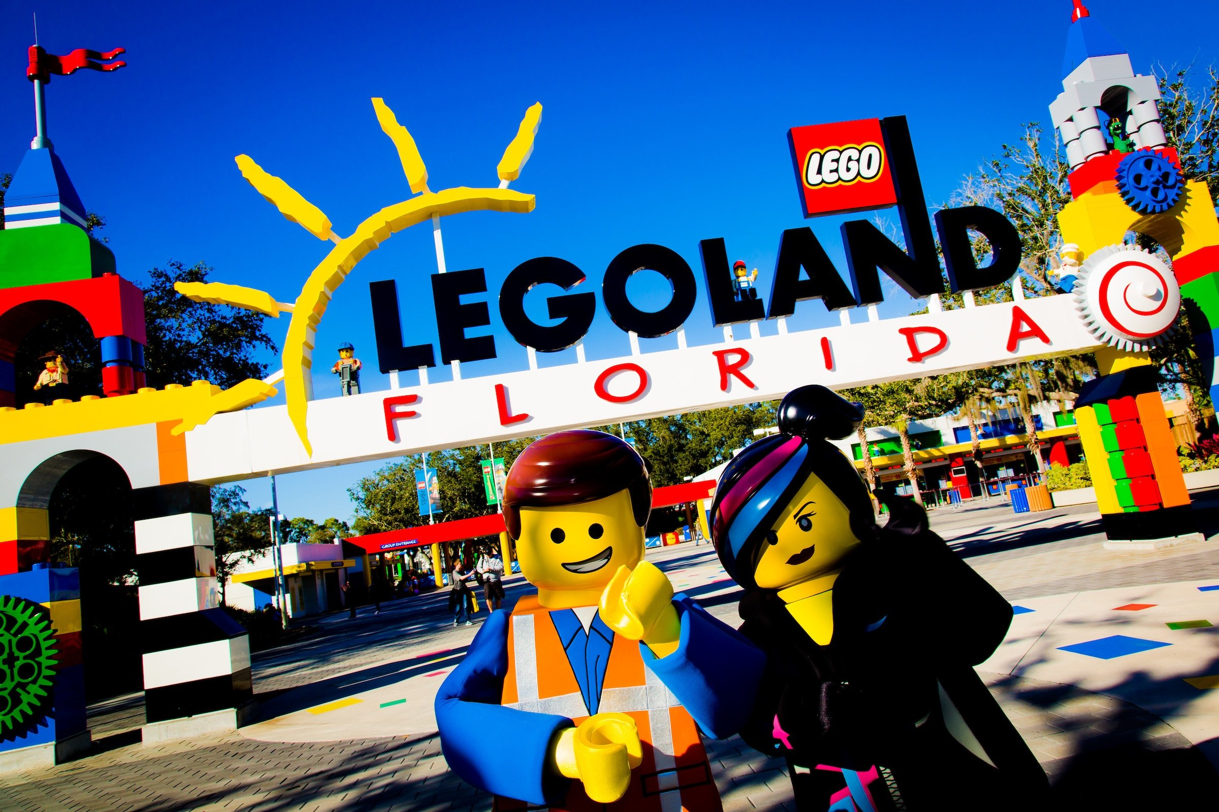 LEGO characters stand in front of the LEGOLAND Florida entrance.