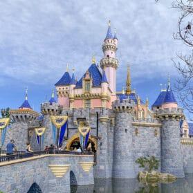 Guests walk through Sleeping Beauty's Castle at Disneyland.