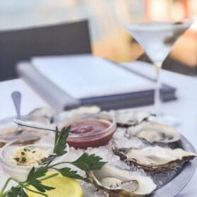 A plate of oysters at Happy Hour on the patio at Eddie V's La Jolla