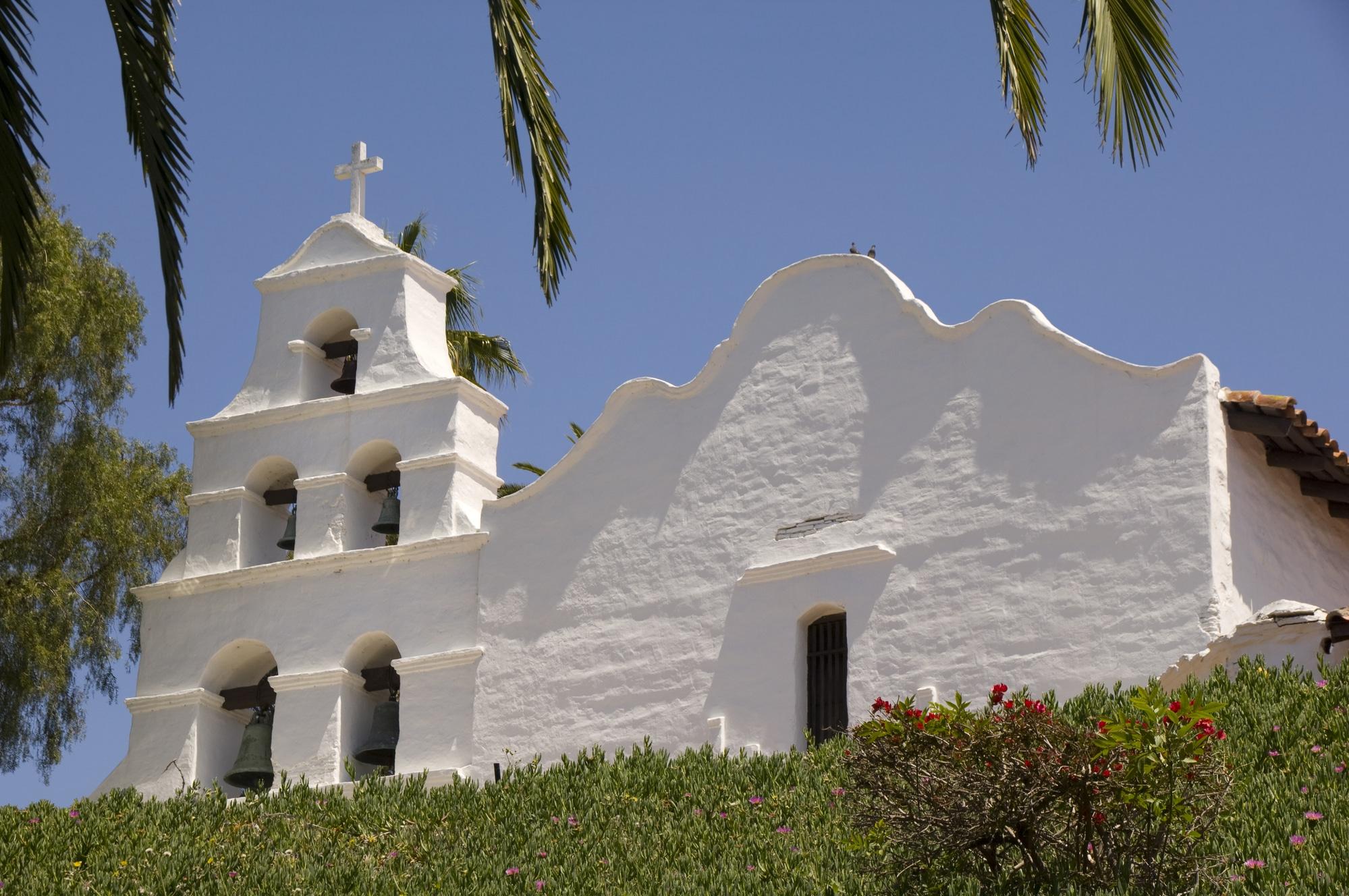 Mission San Diego de Alcala's white stucco facade.