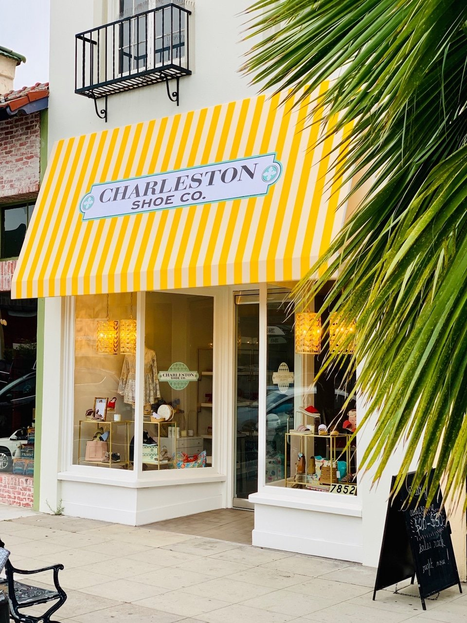 The yellow awning of Charleston Shoe Co., a La Jolla boutique on Girard Avenue.