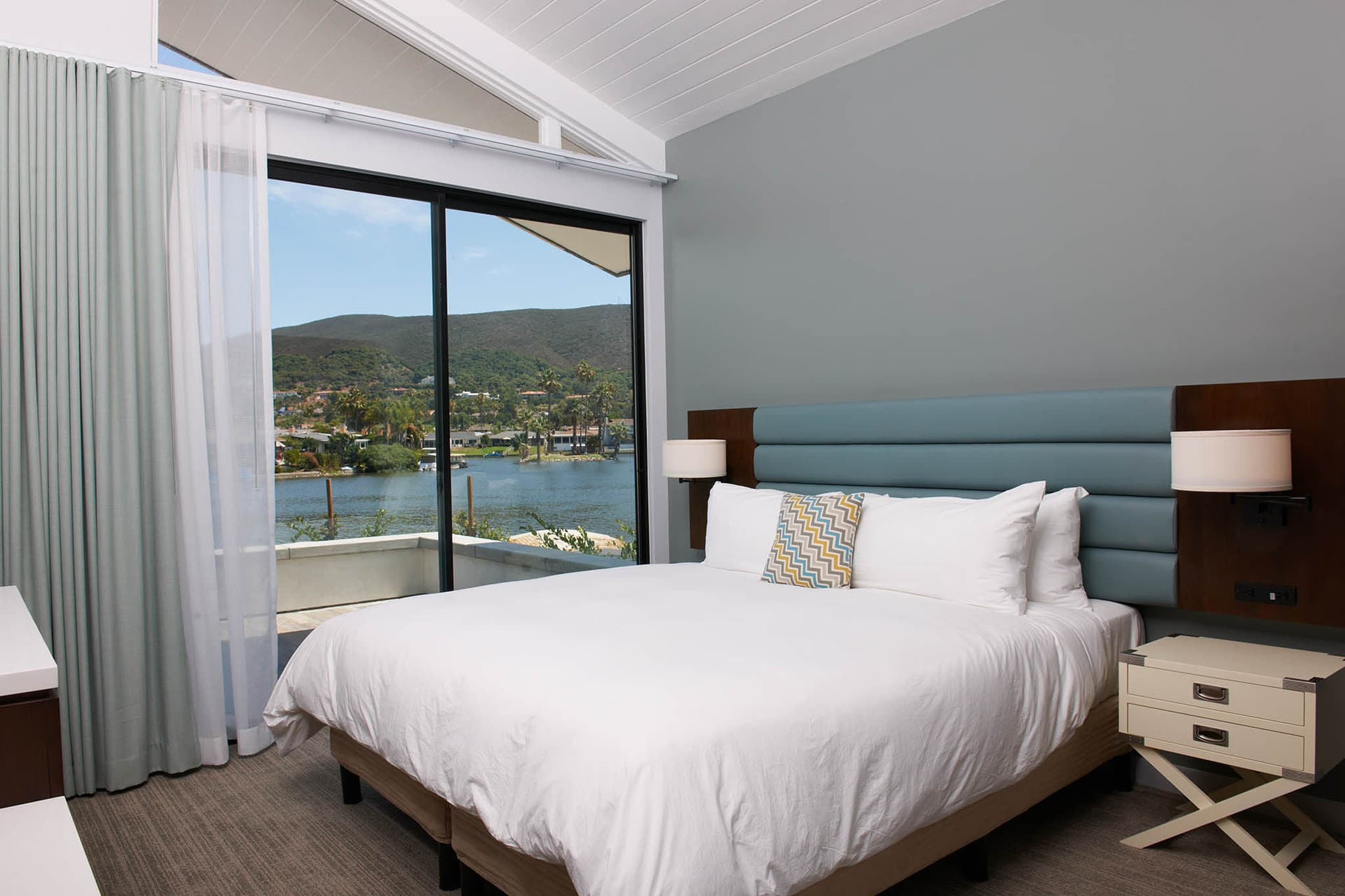 A king room at Lakehouse San Marcos with a view over the lake.