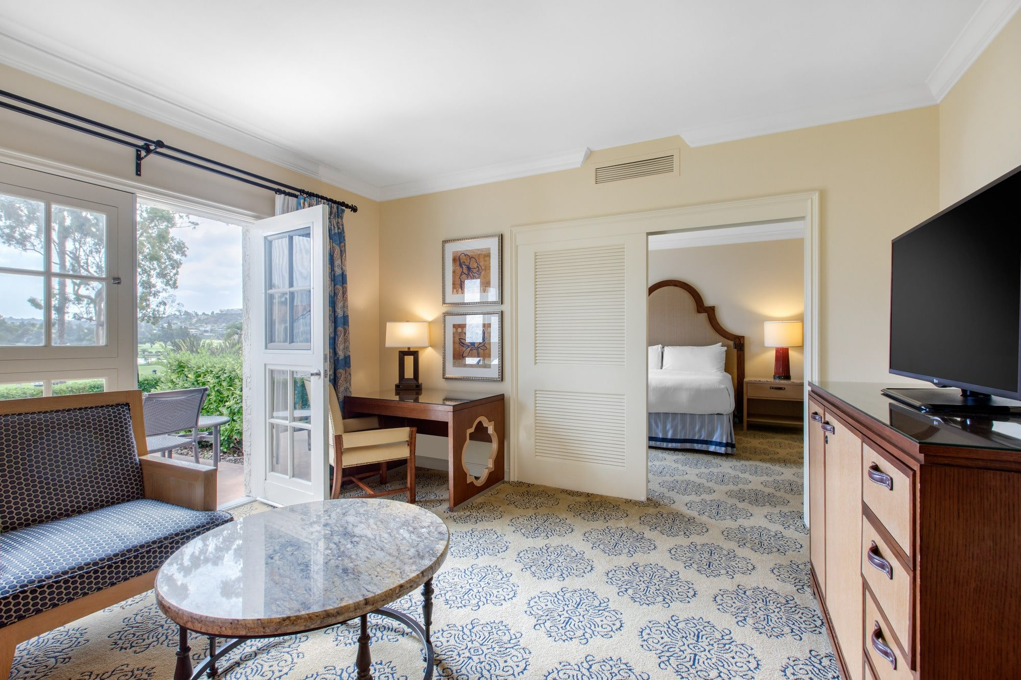From from the living room of the La Costa Suite to the bedroom, which is separated by sliding perforated doors at Omni La Costa resort.