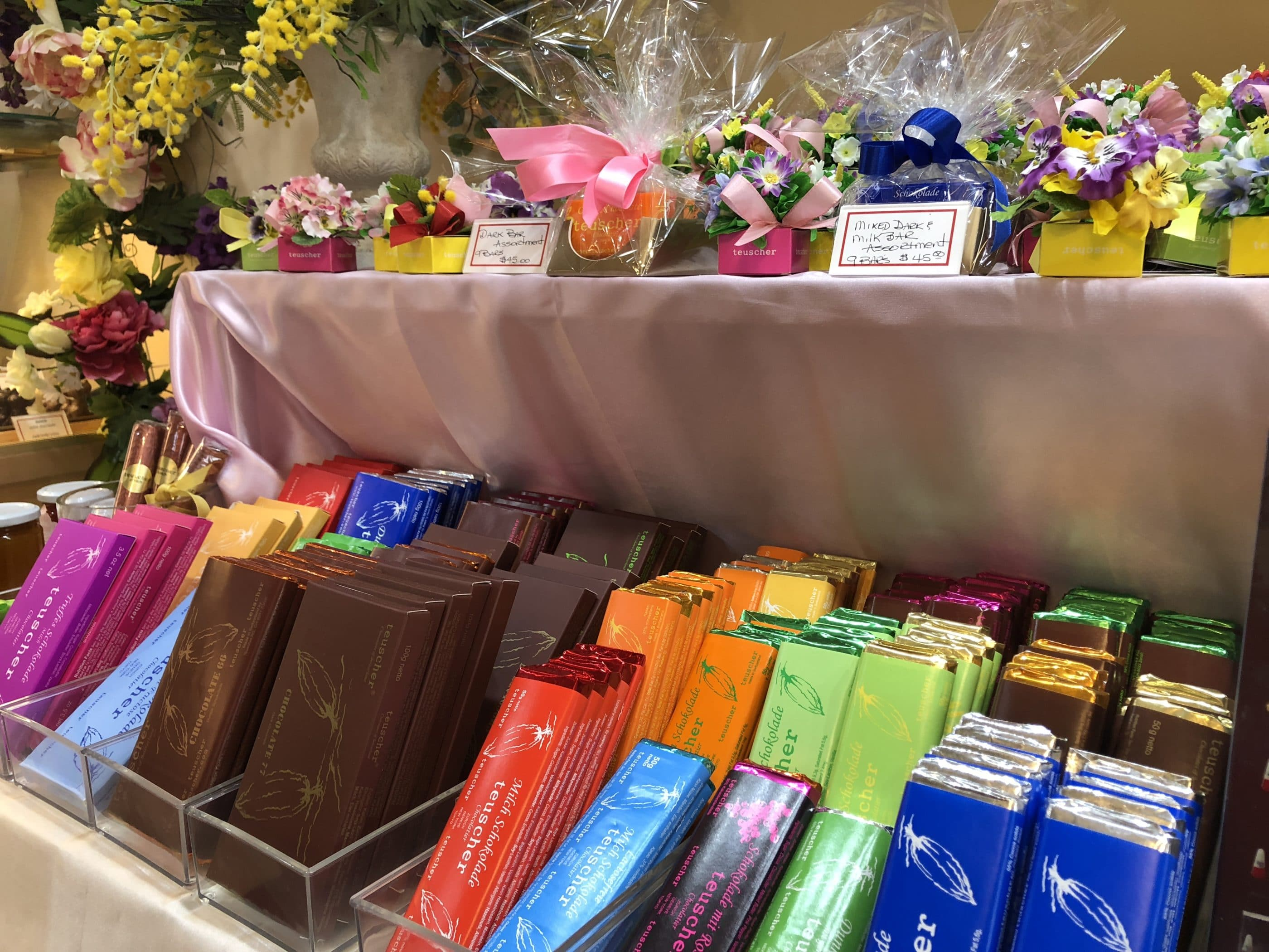 Teuscher bars of chocolate and wrapped gifts to easily take away.