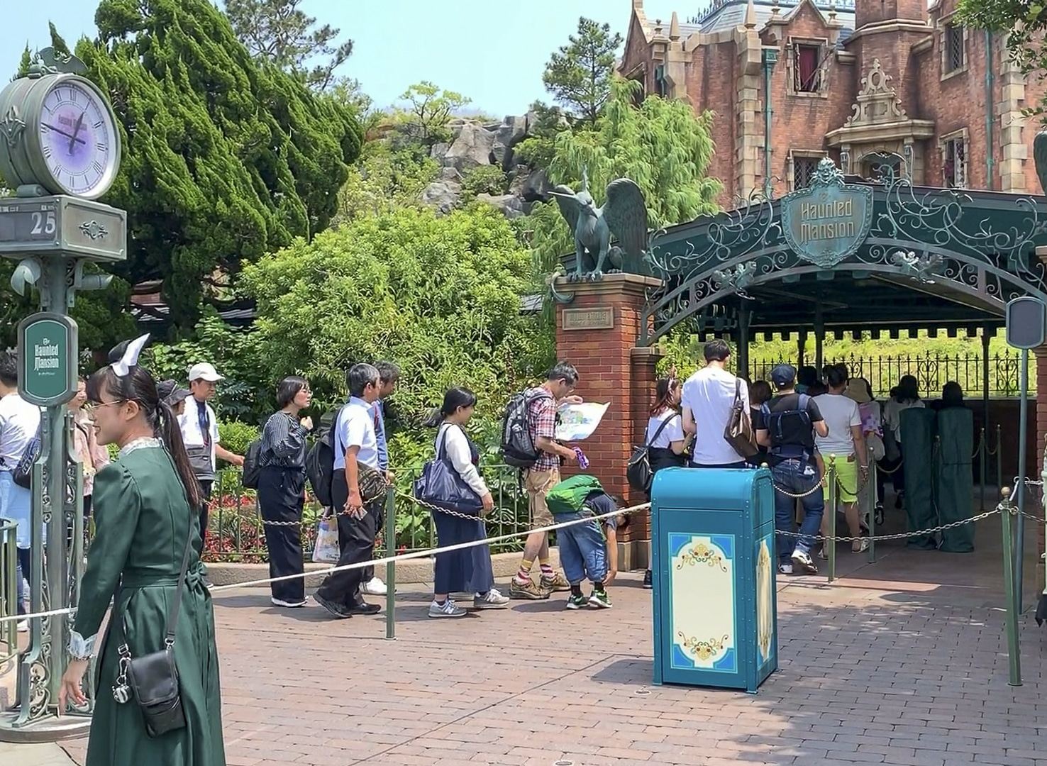 People line up for Haunted Manson at Tokyo Disneyland.
