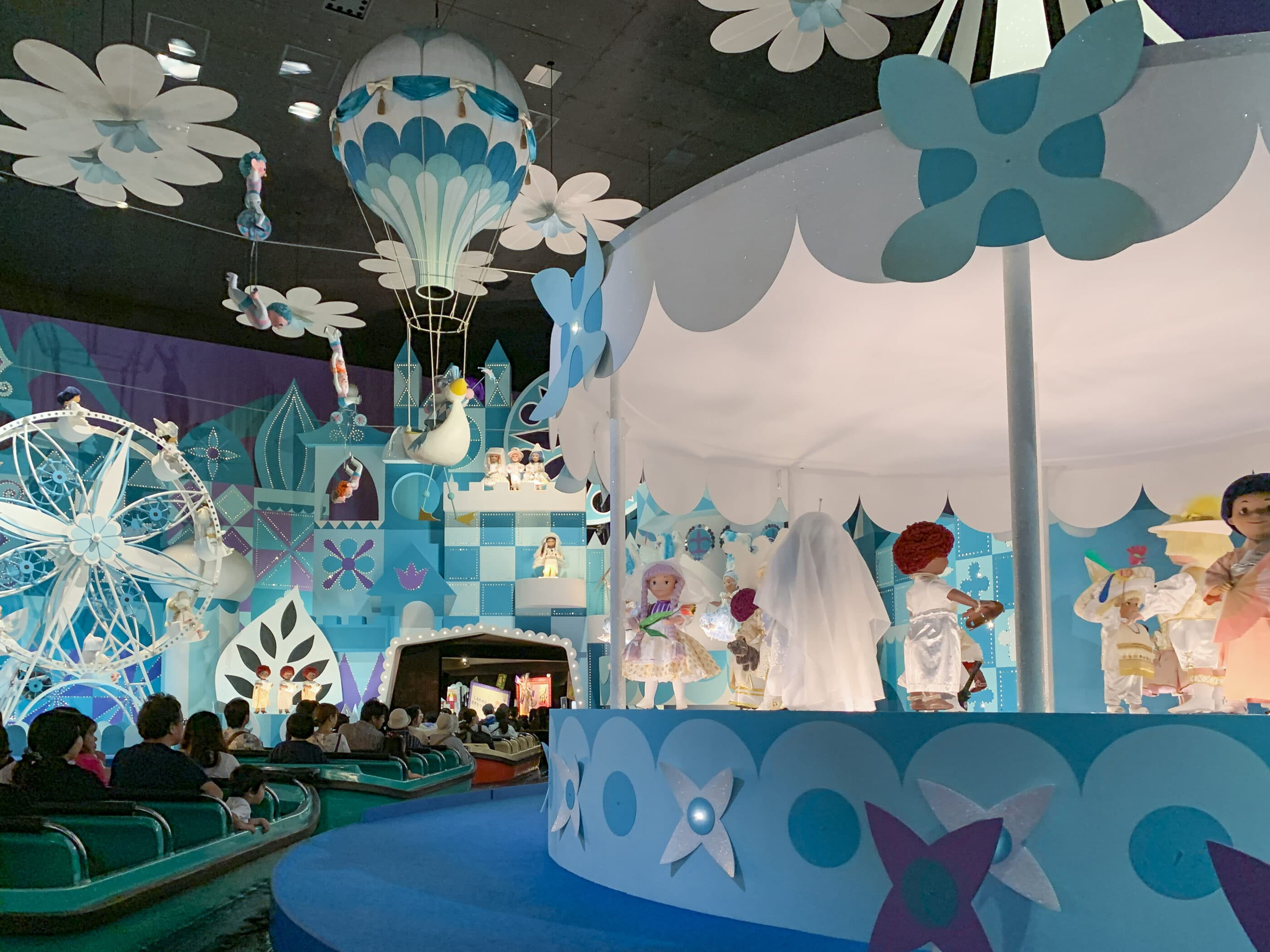 """The """"it's a small world"""" boats ride past singing dolls."""
