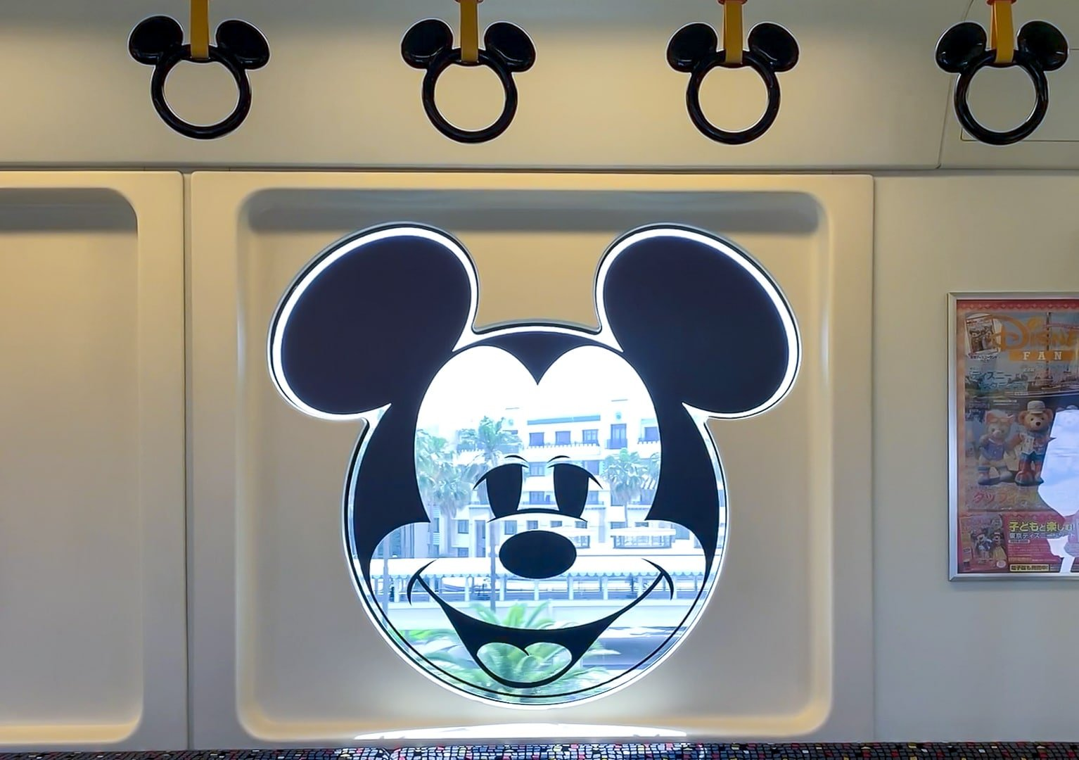 Micky Mouse windows and hand holders in the monorail train.