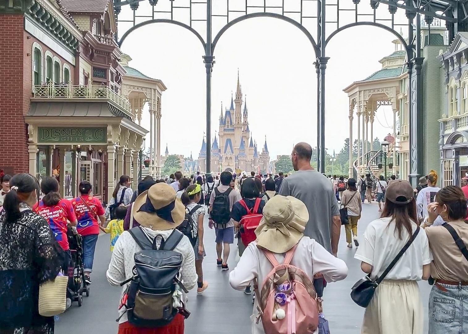 People walk into Tokyo Disneyland through World Bazaar.