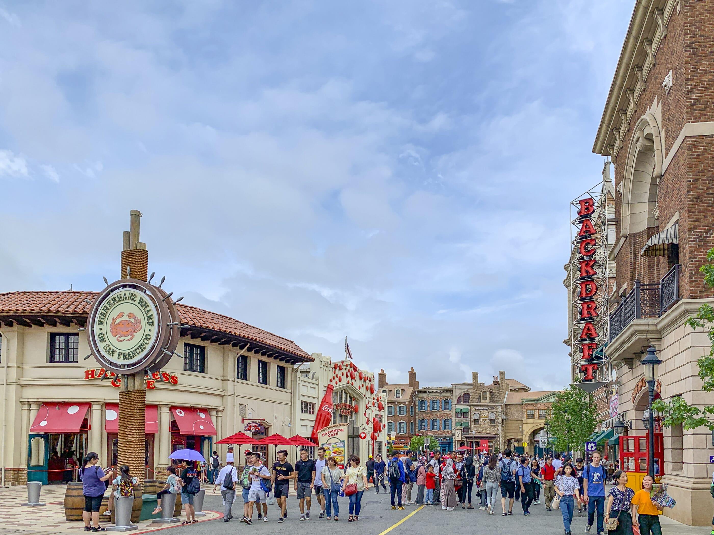 People walk down the street through San Francisco Land at Universal Studios Japan.
