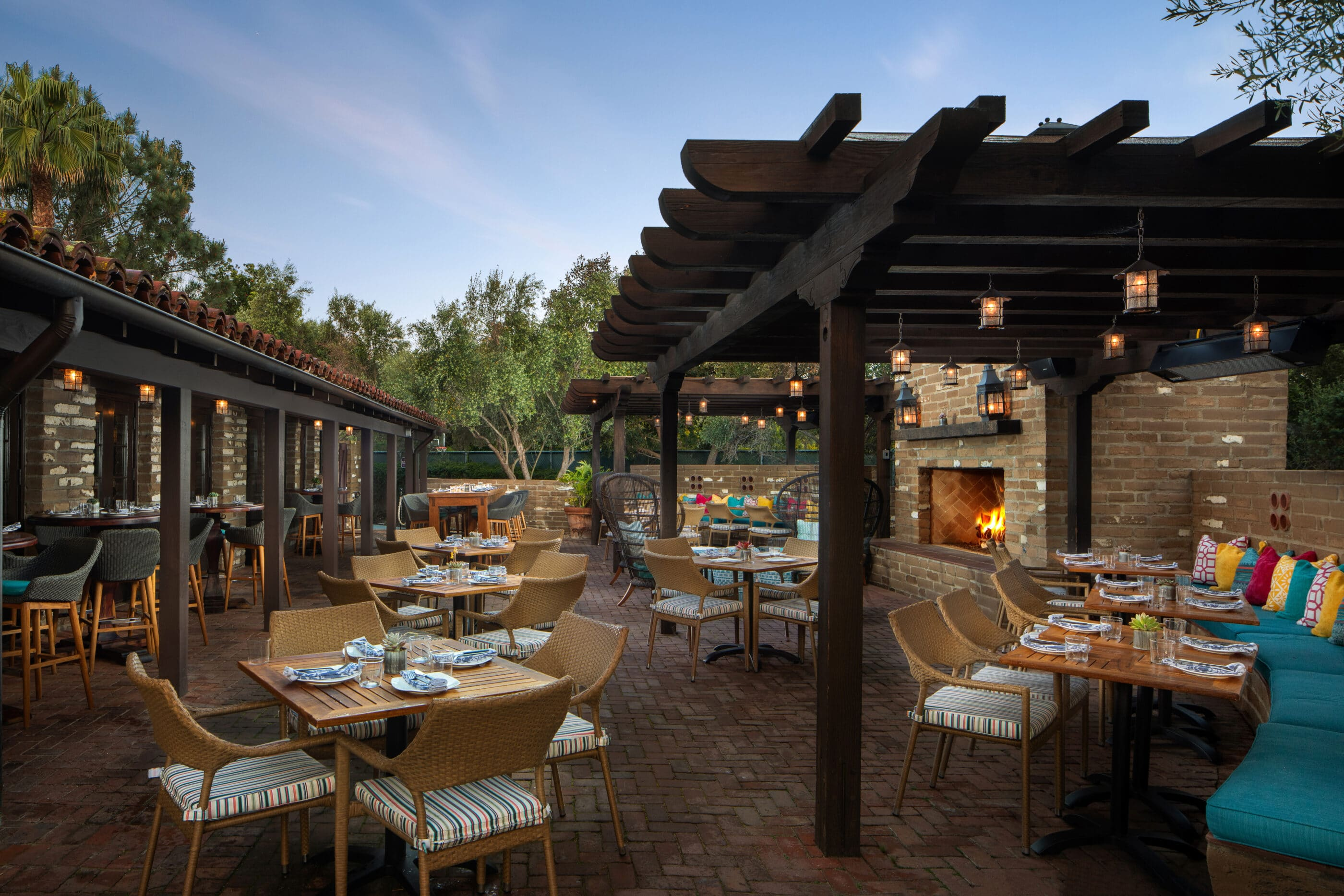 The outdoor patio seating at Mustangs & Burros inside Estancia La Jolla Hotel & Spa.