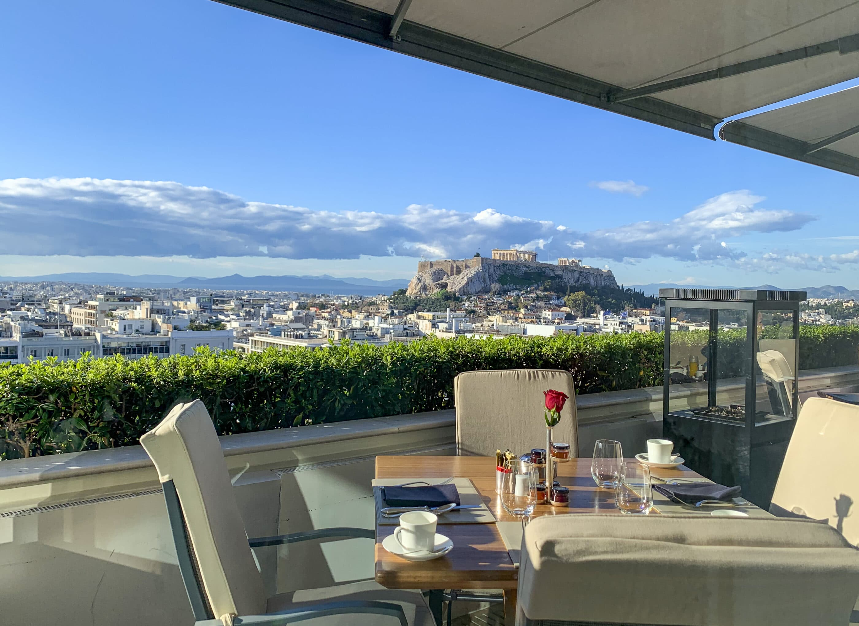 View of the Acropolis and Parthenon from the rooftop restaurant at Hotel Grande Bretagne in Athens, Greece.