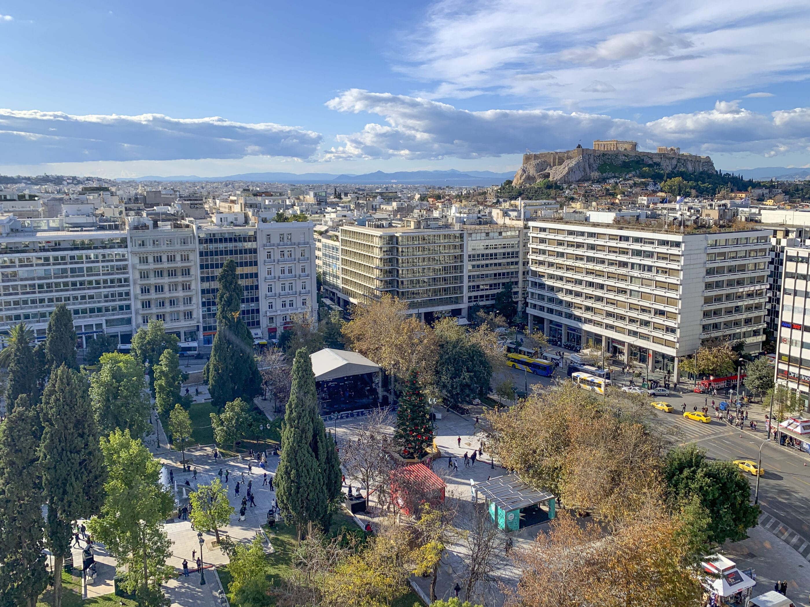 View over Syntagma Square from the GB Roof Garden Restaurant over to the Acropolis.