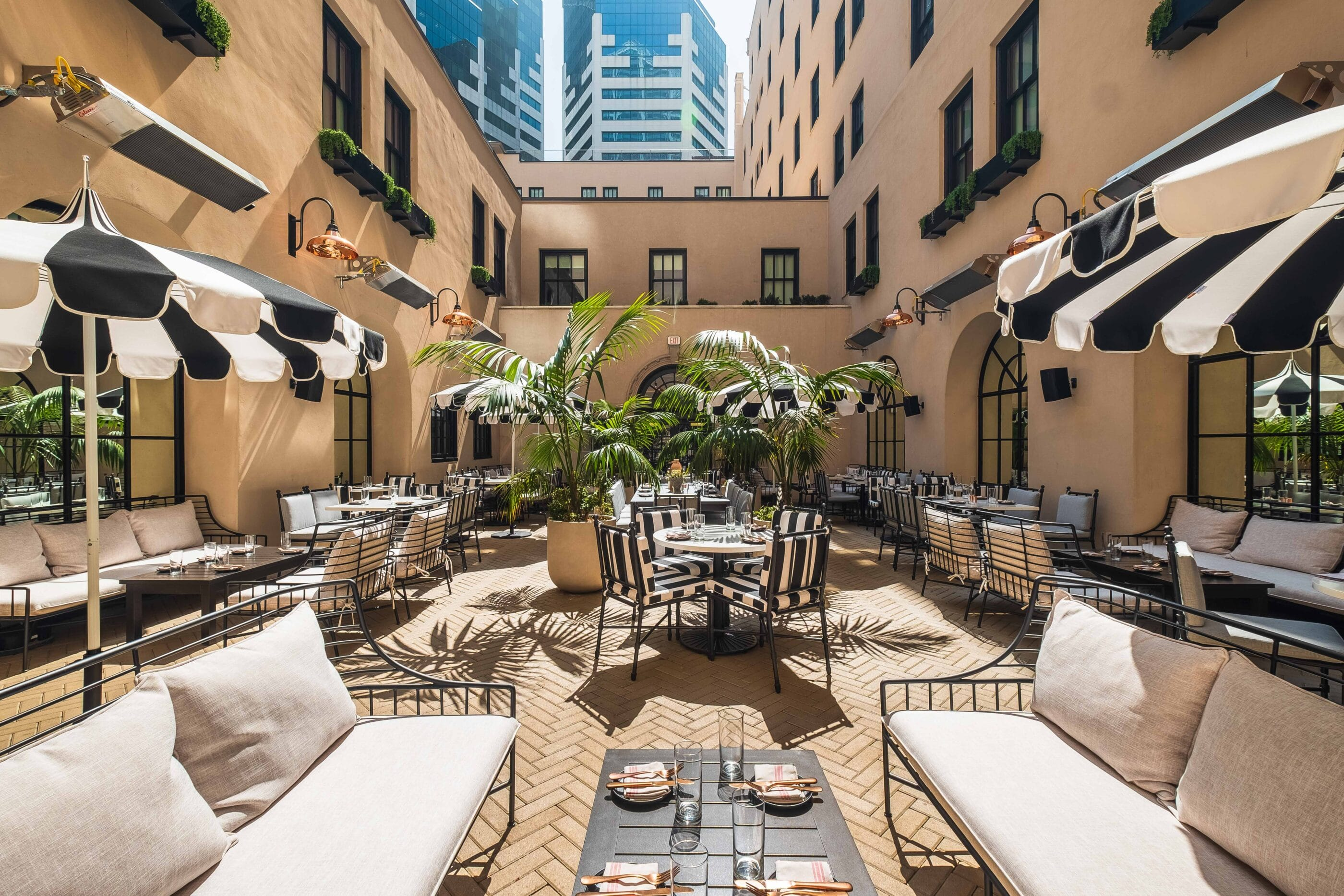 Al fresco dining at Luca Restaurant in a courtyard at The Guild Hotel San Diego.