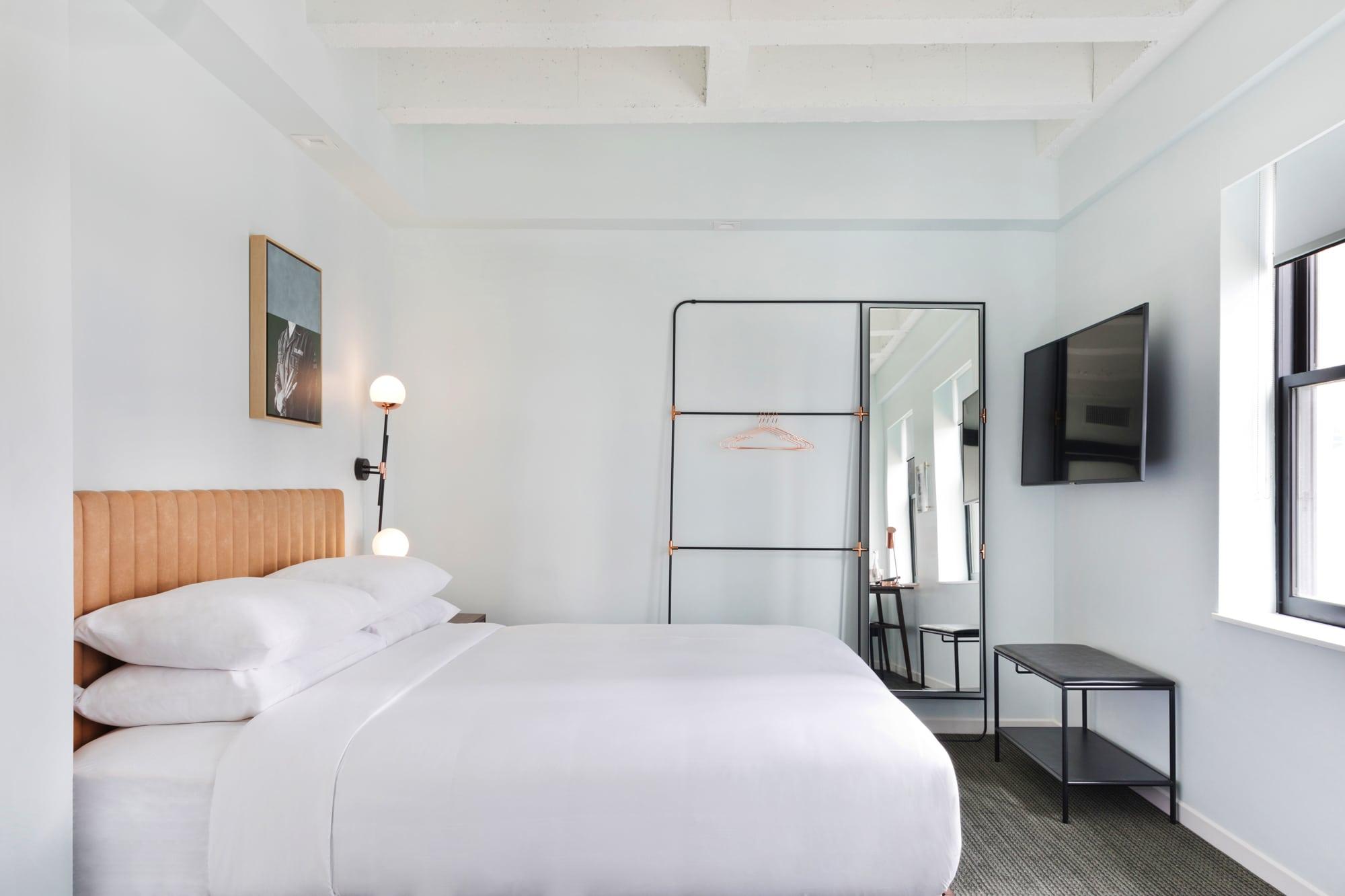 Journeyman king room with fresh white interior.