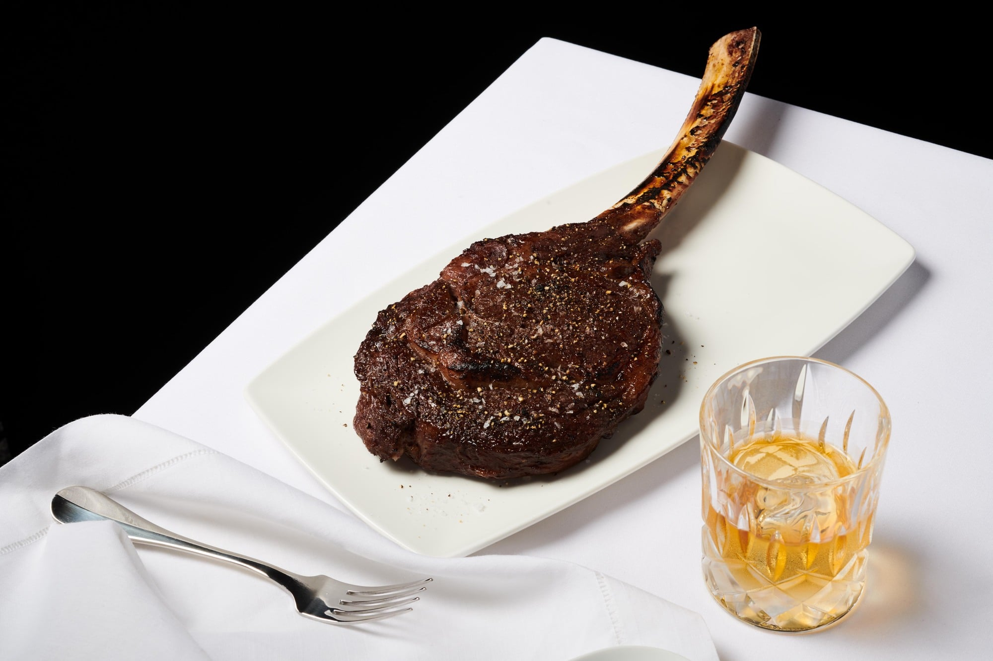 Steak on a white plate at Del Frisco's.