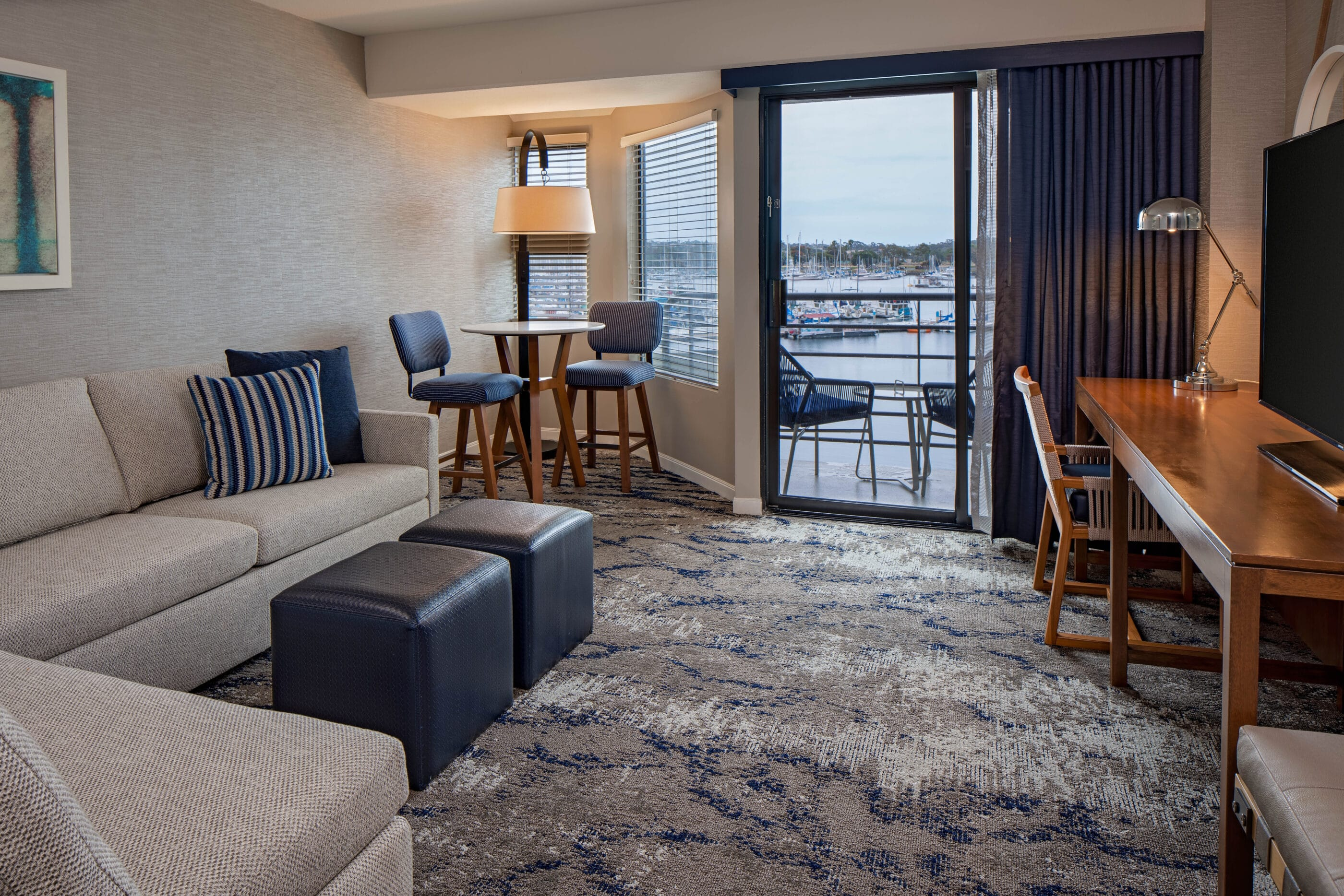 Marina Family Suite living room interior overlooking the marina on the bay.