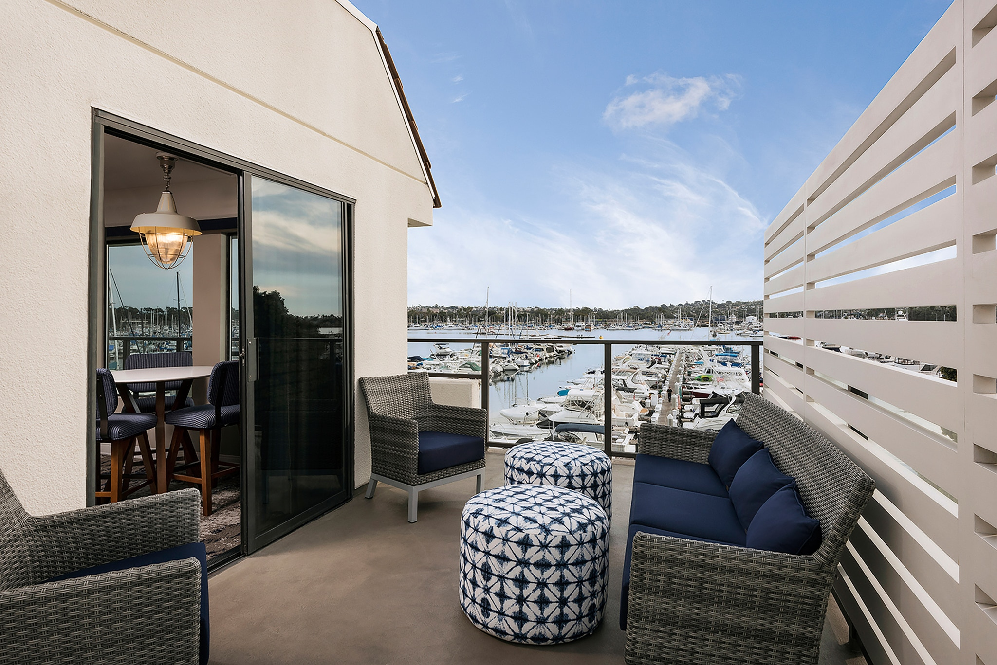 The Veranda Suite furnished balcony overlooking the marina at Hyatt Regency Mission Bay.
