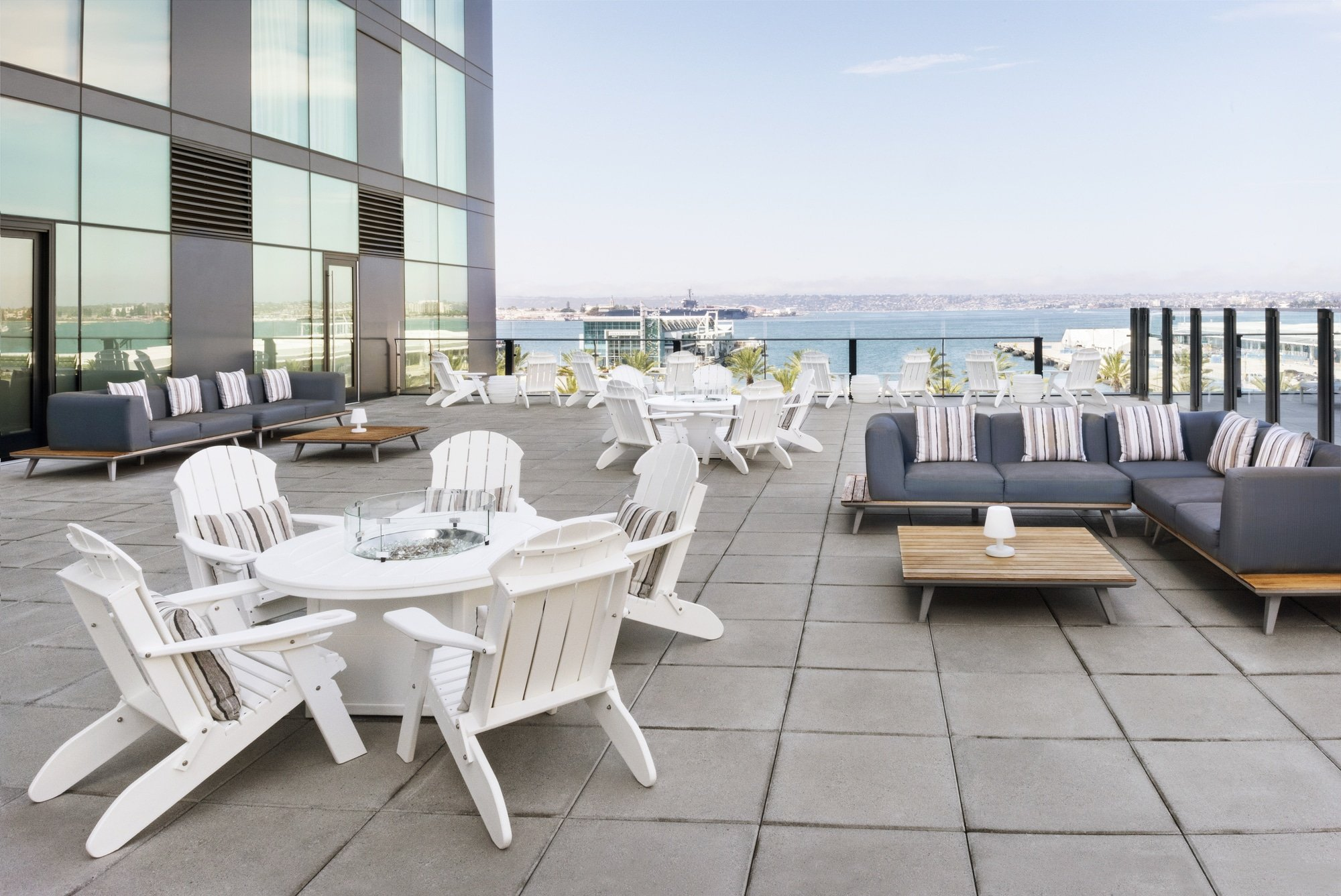 Outdoor seating areas at layover on a sunny day at InterContinental San Diego
