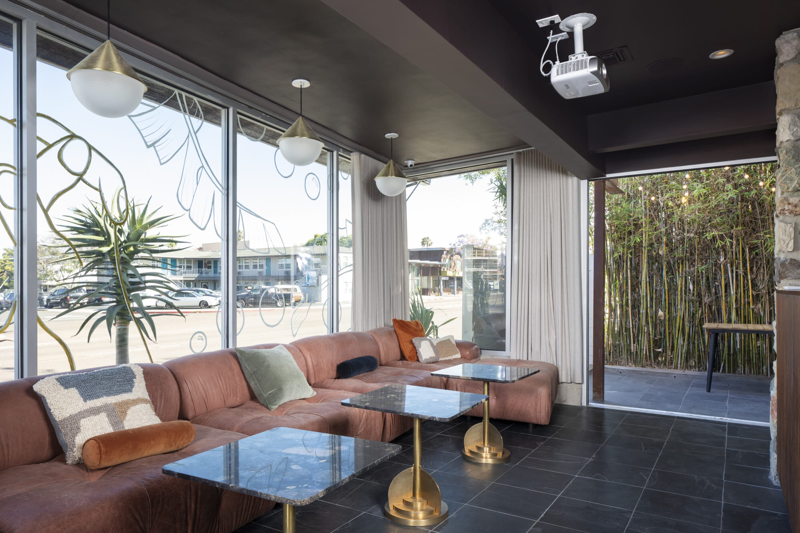 The lounge in the front of the hotel with a view of Rosecrans Street in the background.