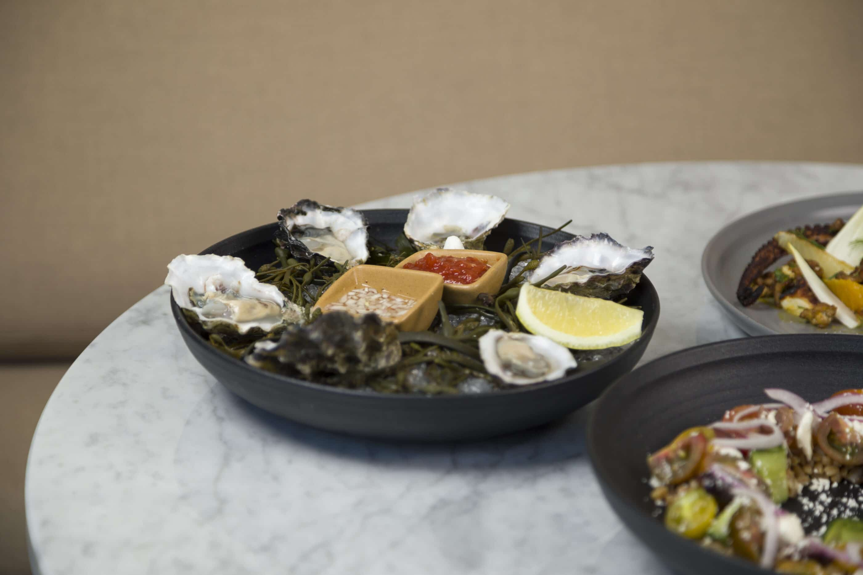 Oysters and other small plates at Charles + Dinorah inside The Pearl Hotel in Point Loma.